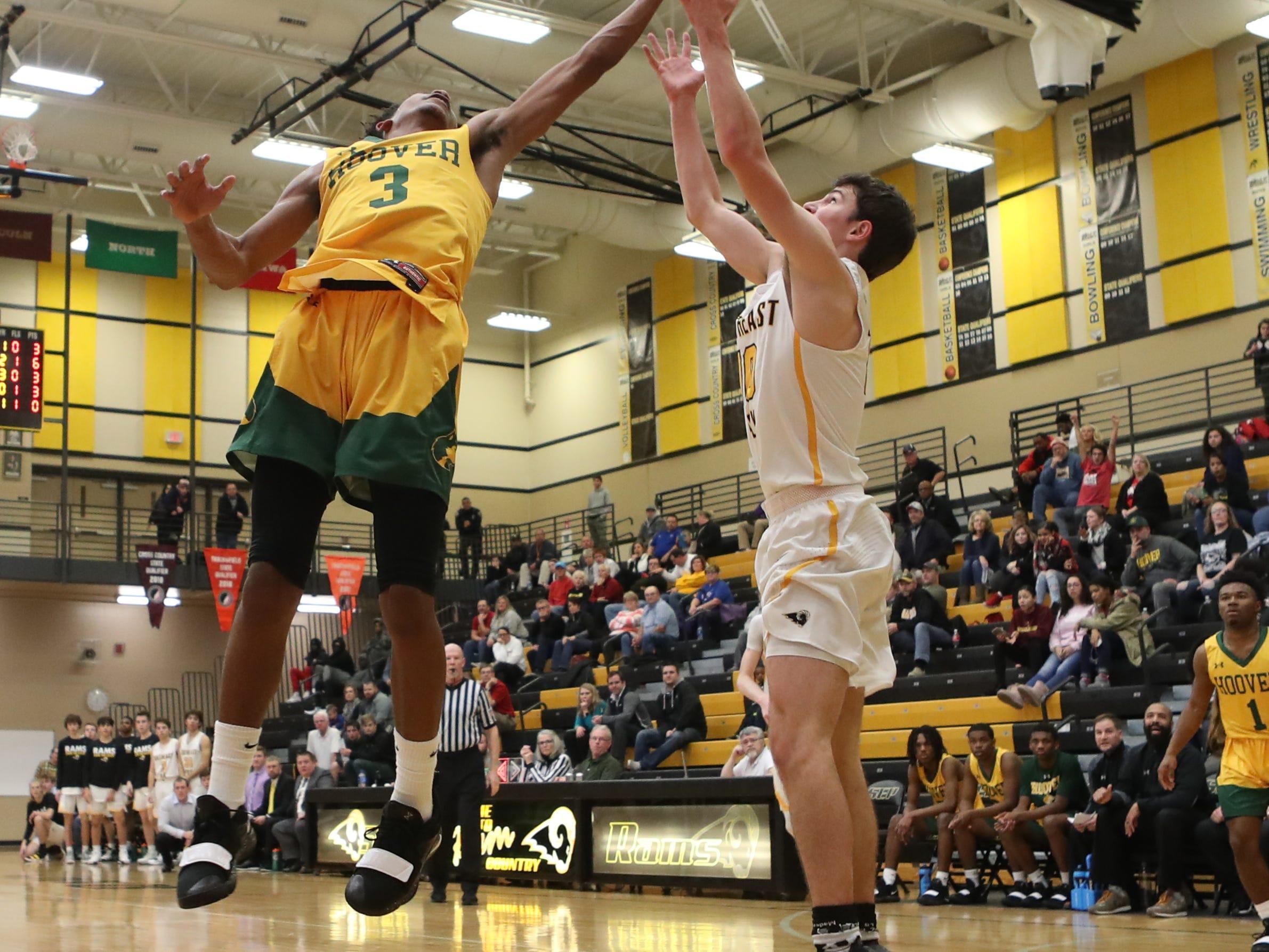 Hoover Huskies Hosea Treadwell (3) out jumps Southeast Polk Rams Daniel Hackbarth (10) for a rebound at Southeast Polk High School.