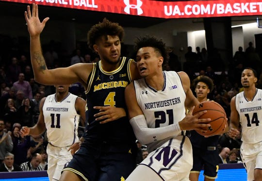 Northwestern forward A.J. Turner goes to the basket as Michigan forward Isaiah Livers defends during the second half at Welsh-Ryan Arena, Dec. 4, 2018, in Evanston, Ill.