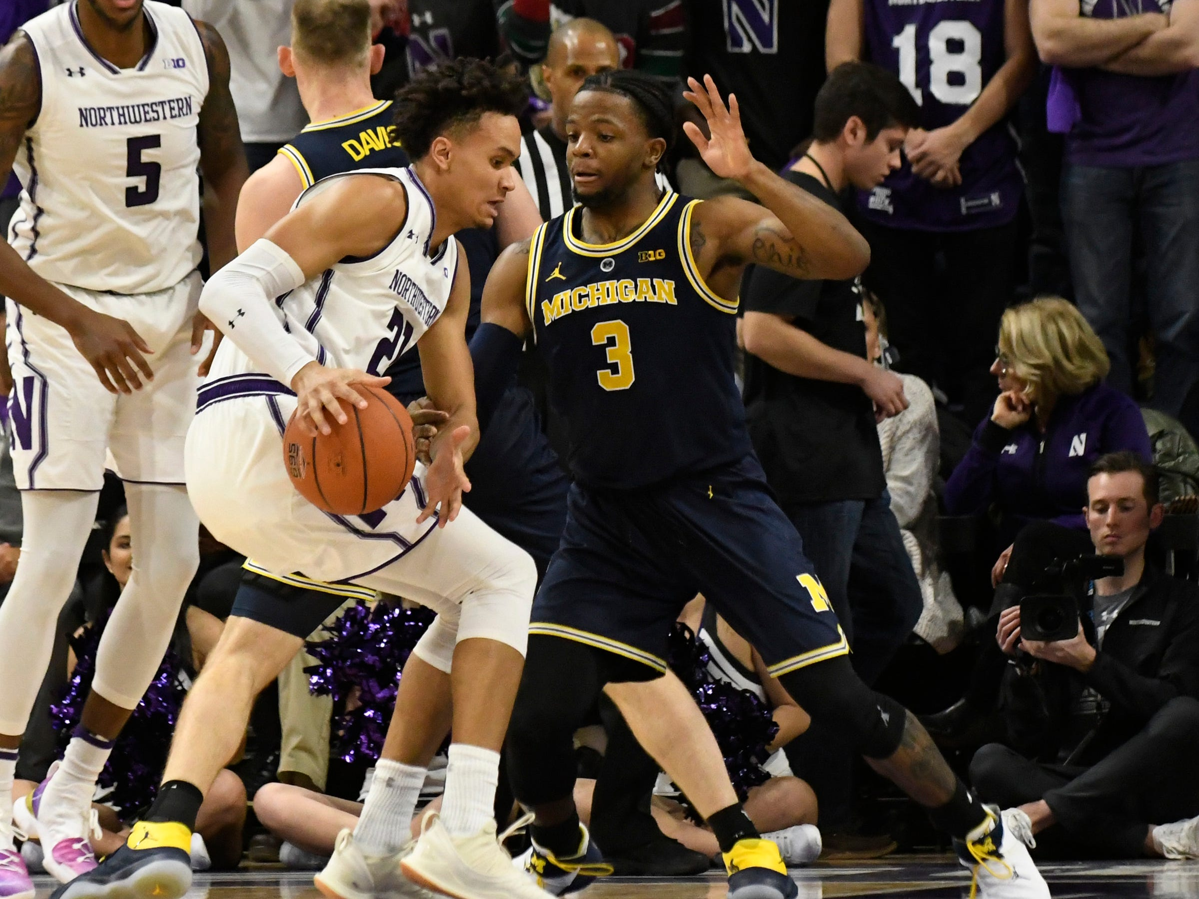 Northwestern forward A.J. Turner is defended by Michigan guard Zavier Simpson during the first half at Welsh-Ryan Arena, Dec. 4, 2018 in Evanston, Ill.