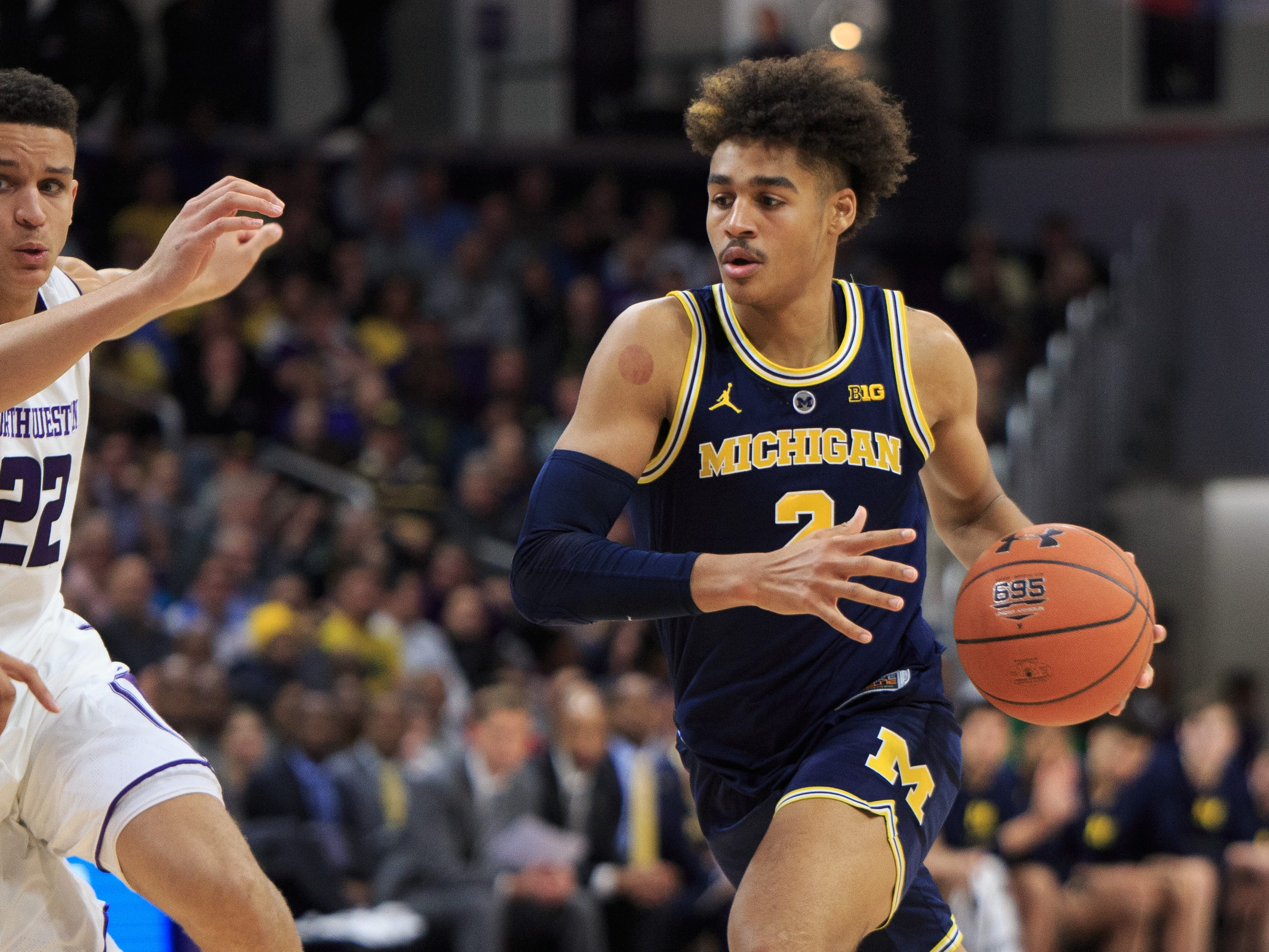 Michigan's Jordan Poole drives to the basket against Northwestern in the first half at Welsh-Ryan Arena on Dec. 4, 2018 in Evanston, Ill.