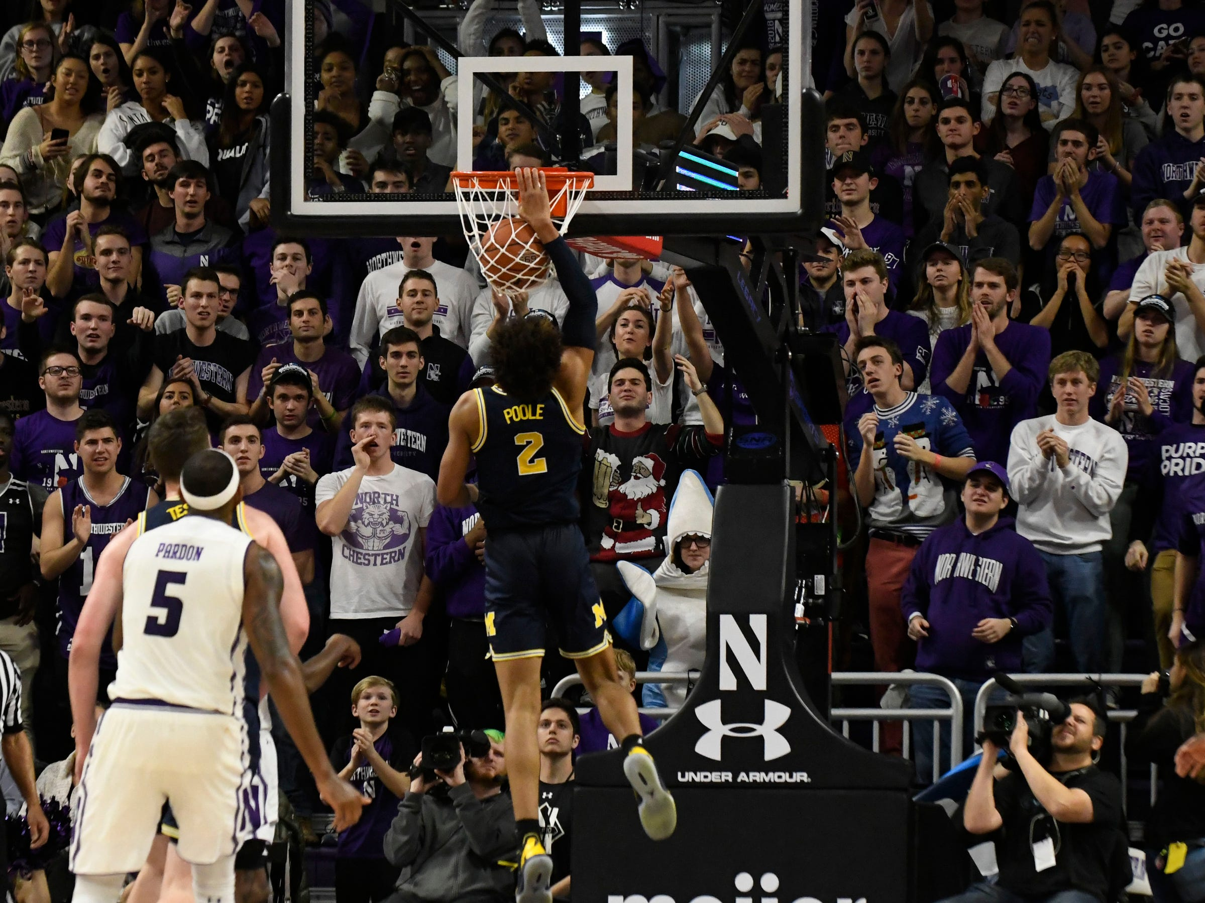 Michigan guard Jordan Poole dunks the ball during the second half of U-M's 62-60 win on Tuesday, Dec. 4, 2018, in Evanston, Ill.