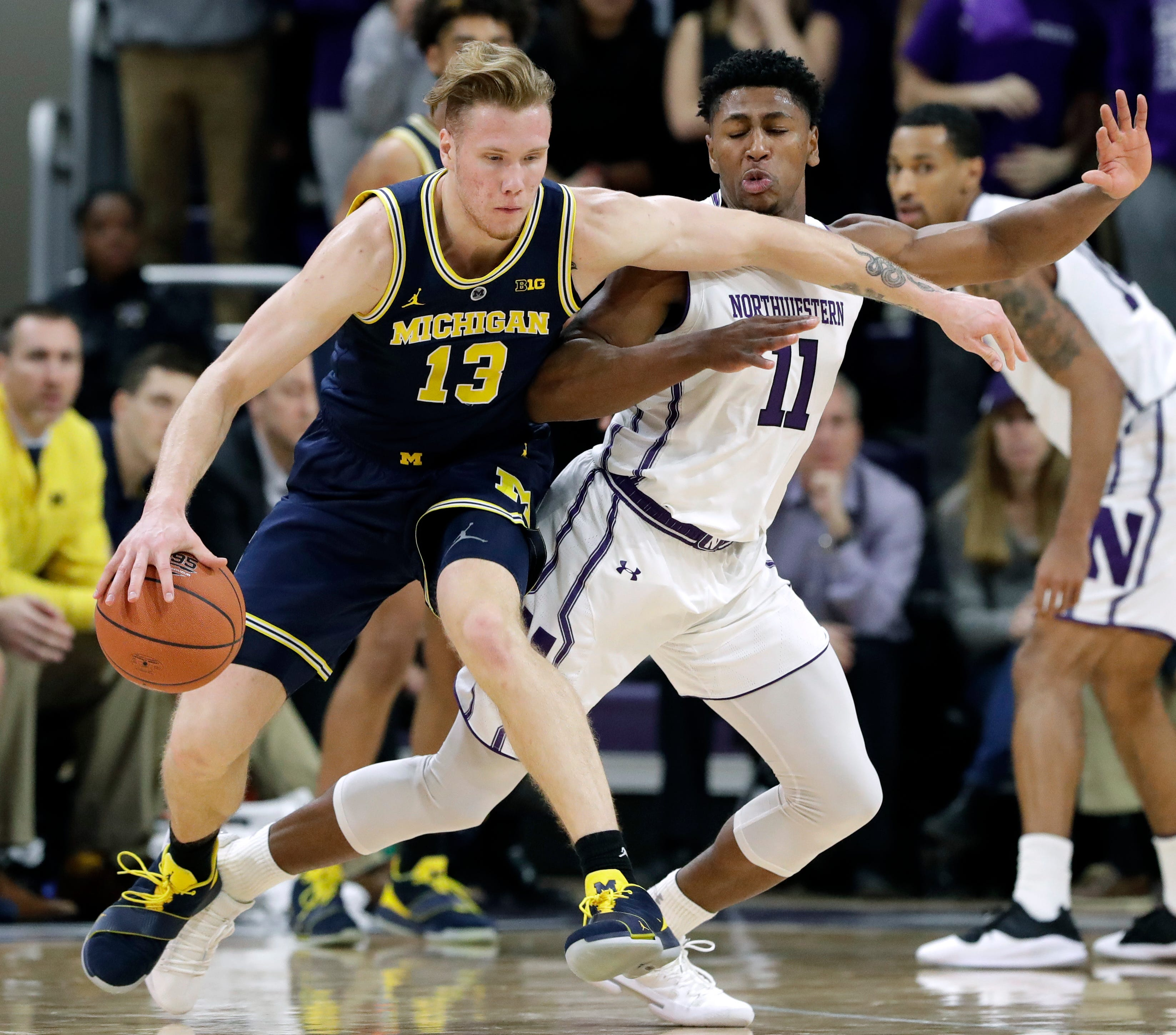 Michigan forward Ignas Brazdeikis, left, drives against Northwestern guard Anthony Gaines during the second half of U-M's 62-60 win on Tuesday, Dec. 4, 2018, in Evanston, Ill.