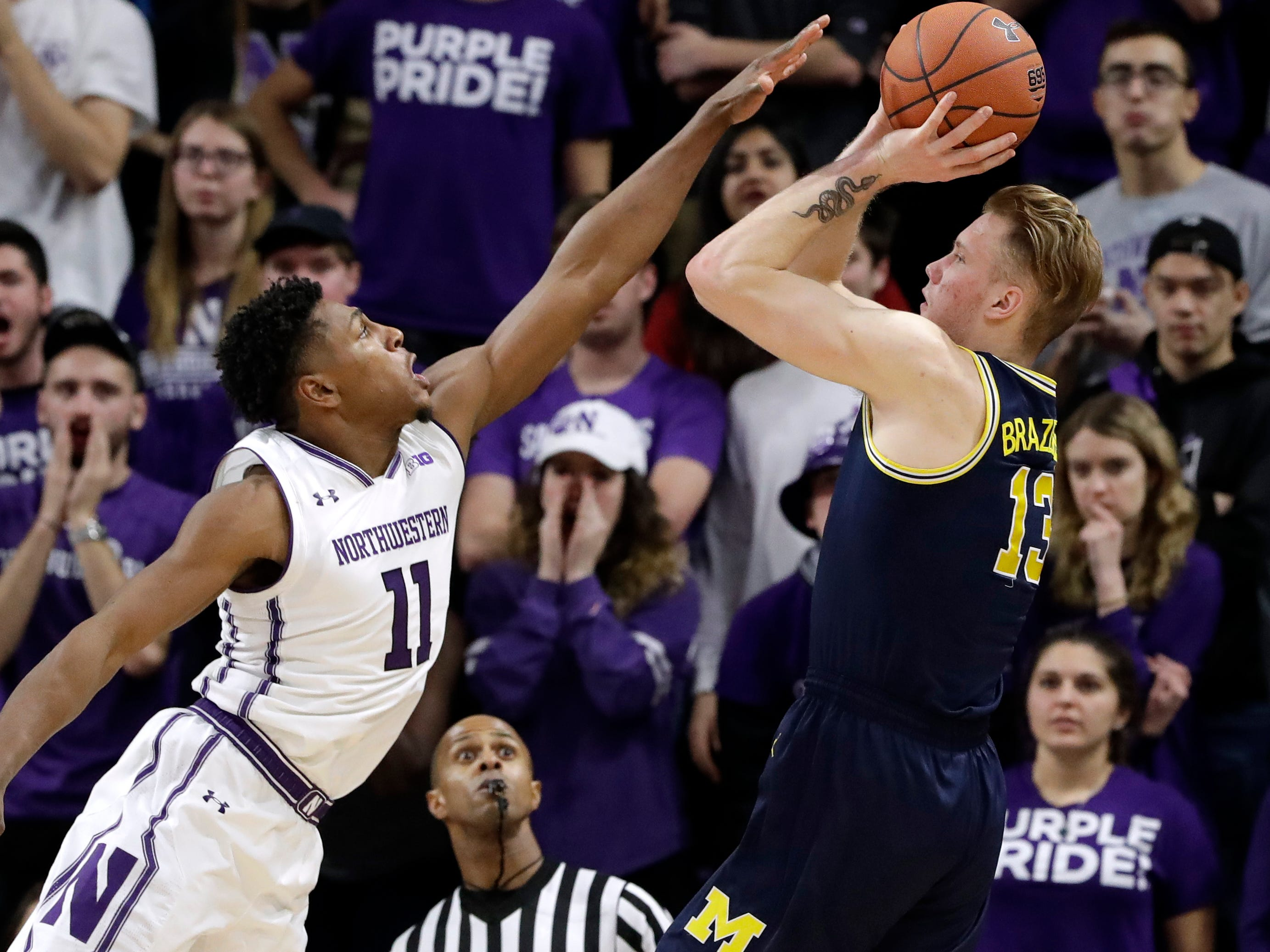 Michigan forward Ignas Brazdeikis, right shoots against Northwestern guard Anthony Gaines during the second half of U-M's 62-60 win on Tuesday, Dec. 4, 2018, in Evanston, Ill.