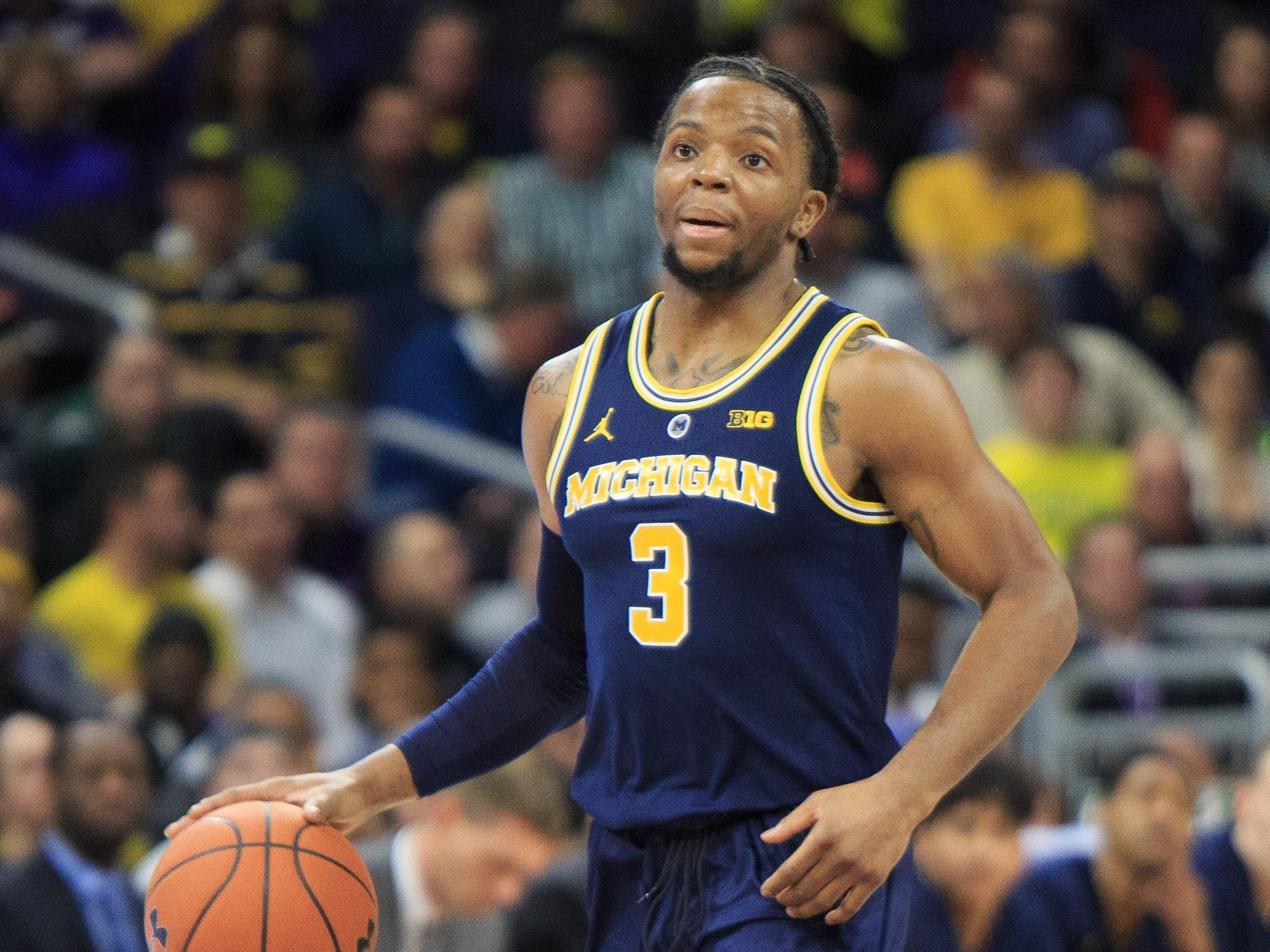Michigan's Zavier Simpson dribbles against Northwestern in the first half at Welsh-Ryan Arena on Dec. 4, 2018 in Evanston, Ill.