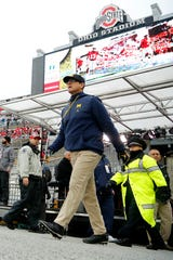 Michigan coach Jim Harbaugh walks on to the field before a game against Ohio State at Ohio Stadium, Nov. 24, 2018.