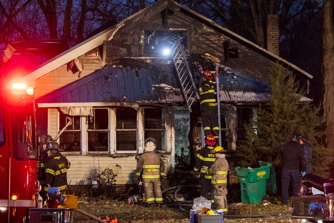 Firefighters work the scene of a fatal house fire in White Pigeon, Mich., on Tuesday, Dec. 4, 2018.