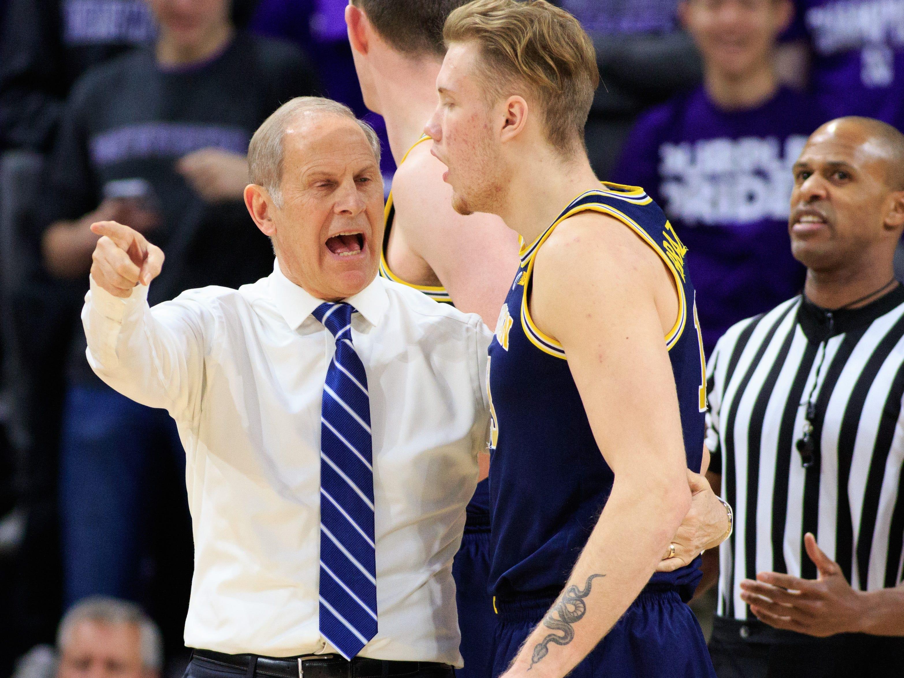 Michigan coach John Beilein talks to Ignas Brazdeikis during a timeout against Northwestern at Welsh-Ryan Arena on Dec. 4, 2018 in Evanston, Ill.