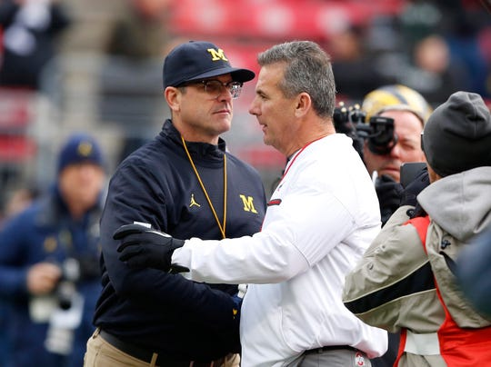 Michigan coach Jim Harbaugh and Ohio State coach Urban Meyer shake hands before the game at Ohio Stadium, Nov. 26, 2016. Ohio State won 30-27.