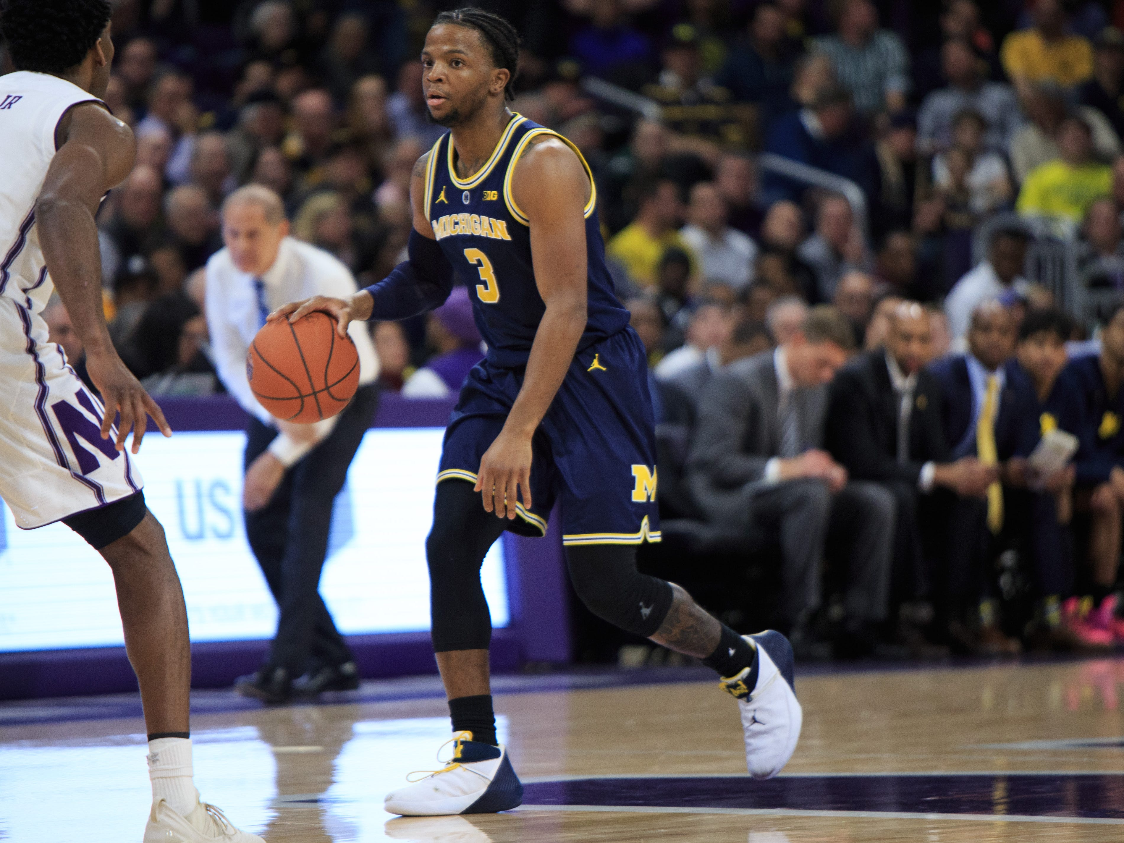 Michigan's Zavier Simpson brings the ball up the court in the game against Northwestern in the first half at Welsh-Ryan Arena on Dec. 4, 2018 in Evanston, Ill.