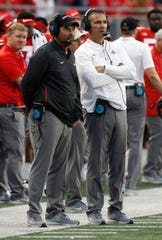 Ohio State head coach Urban Meyer, right, and offensive coordinator Ryan Day watch from the sideline against Tulane during the second half in Columbus, Ohio, Sept. 22, 2018.