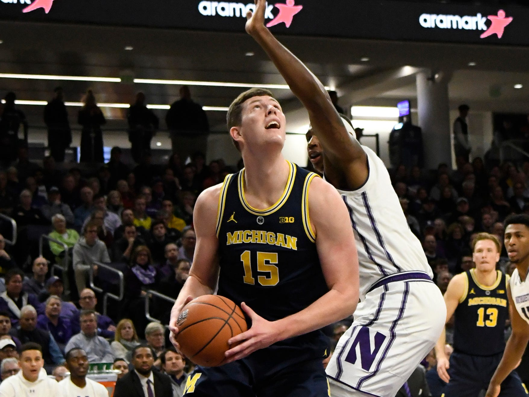 Michigan center Jon Teske is defended by Northwestern center Dererk Pardon during the first half at Welsh-Ryan Arena, Dec. 4, 2018 in Evanston, Ill.