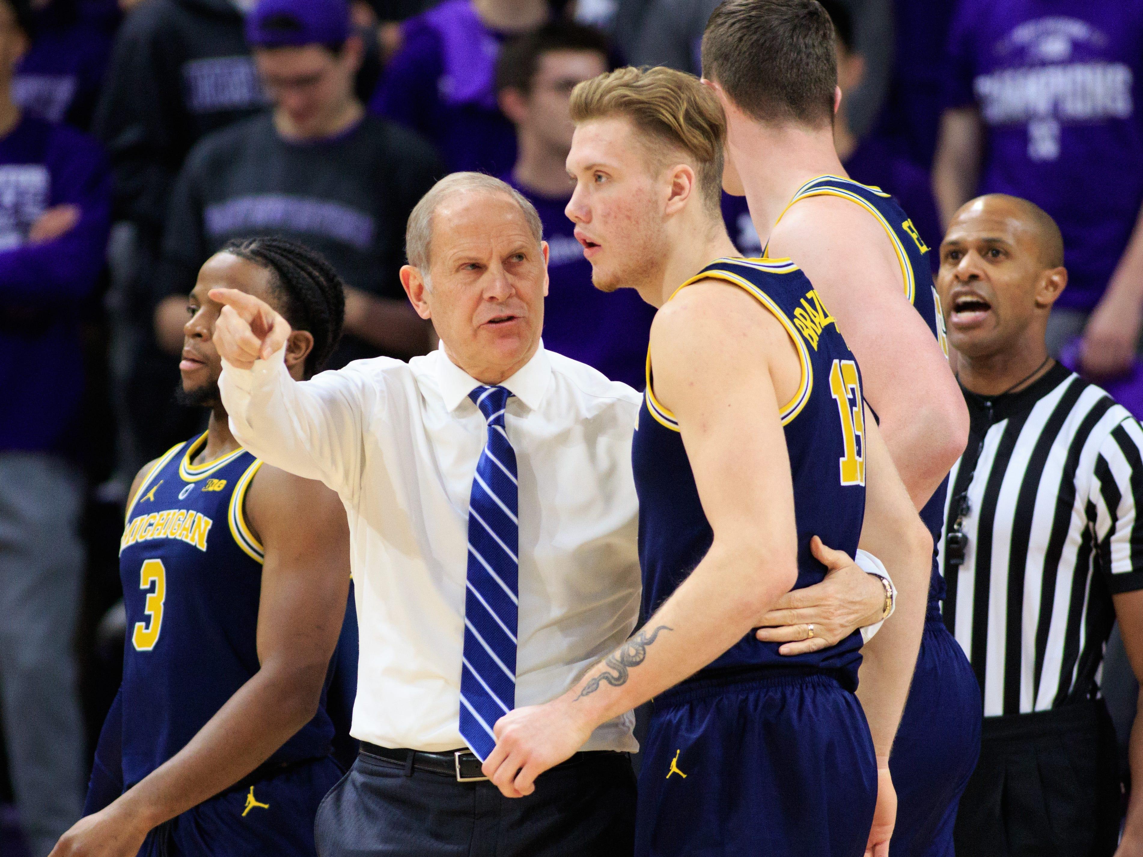 Michigan coach John Beilein talks to Ignas Brazdeikis against Northwestern at Welsh-Ryan Arena on Dec. 4, 2018 in Evanston, Ill.