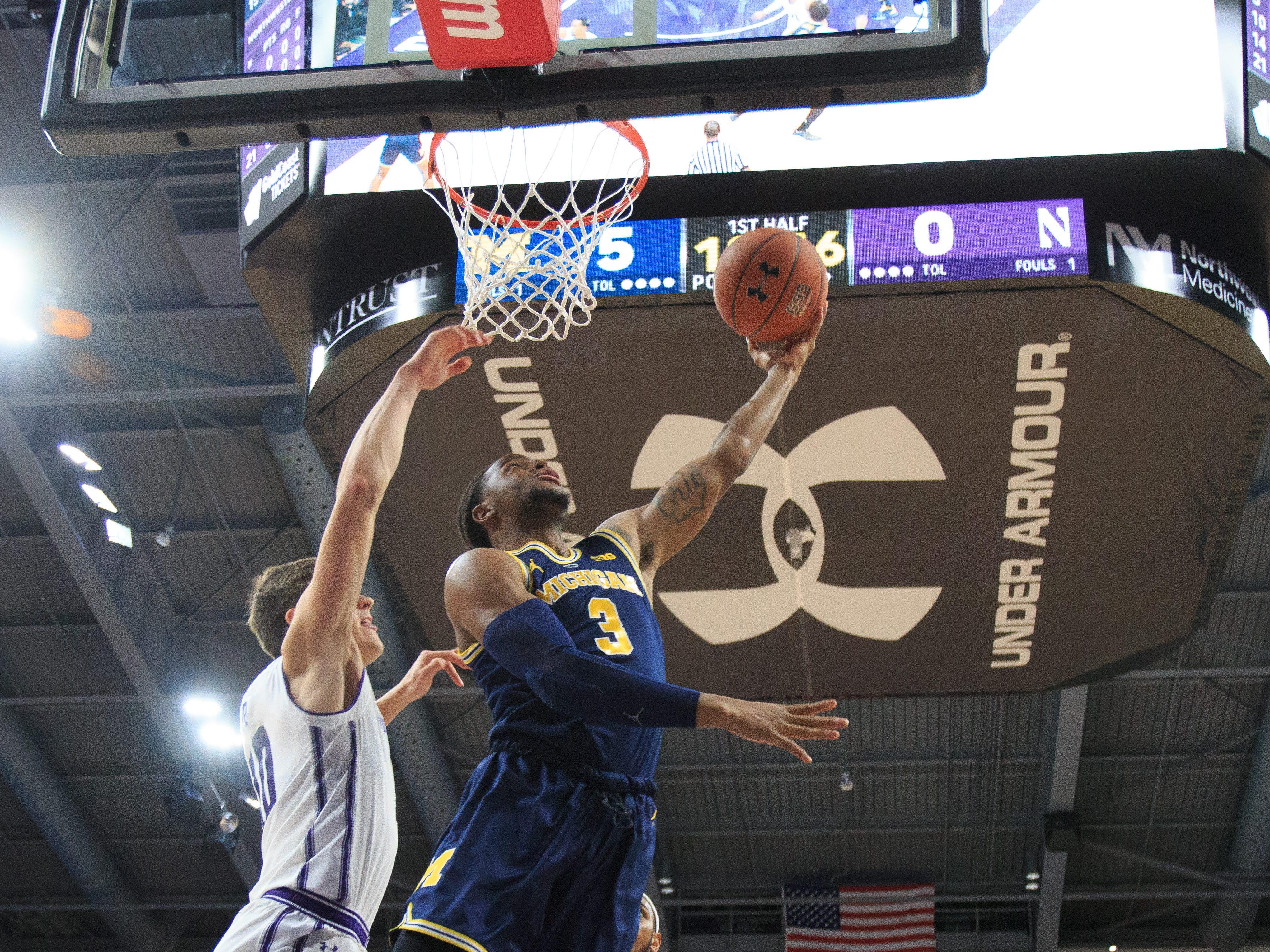Michigan's Zavier Simpson drives to the basket during the first half against Northwestern at Welsh-Ryan Arena on Dec. 4, 2018 in Evanston, Ill.
