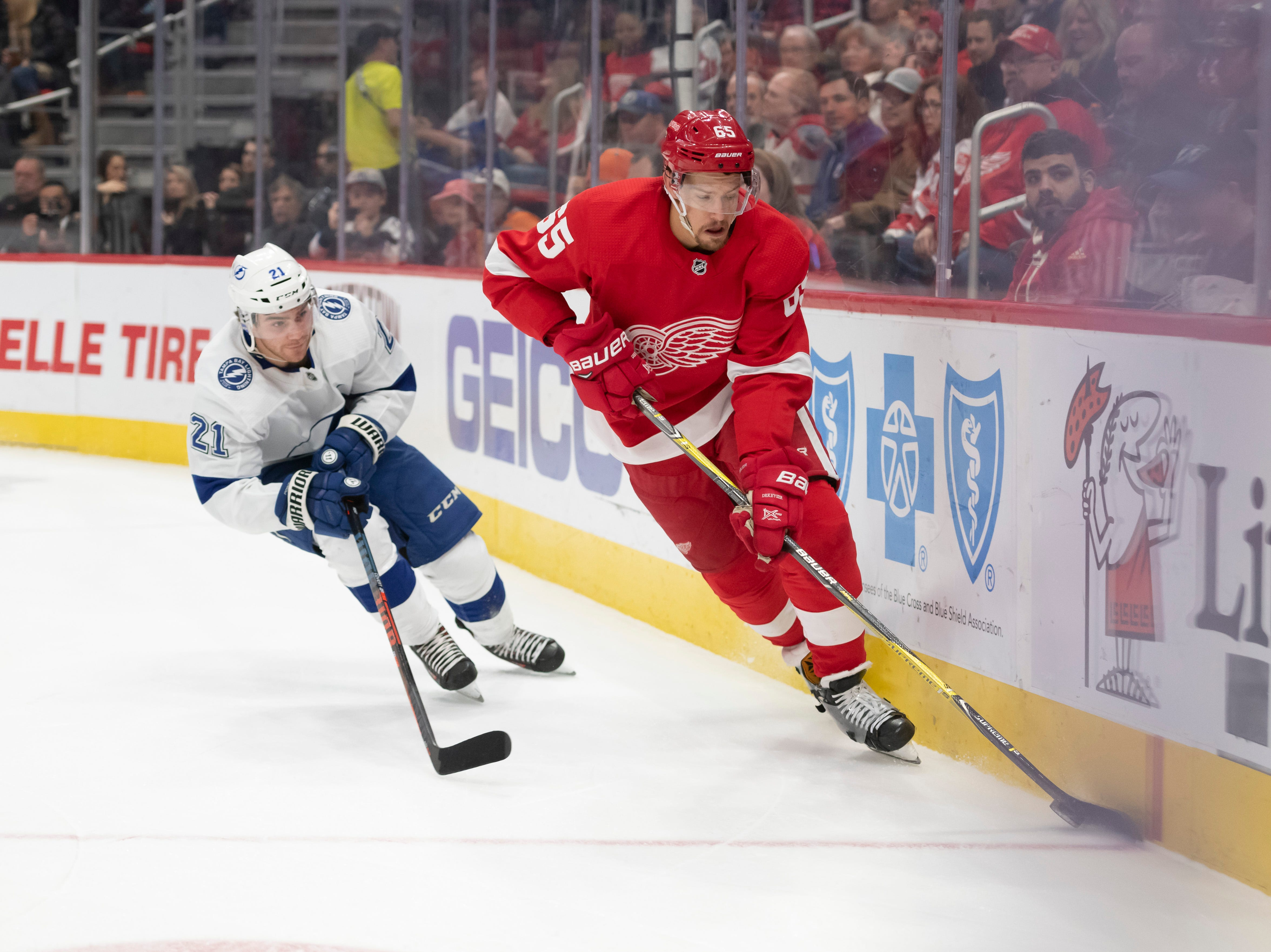Detroit defenseman Danny DeKeyser keeps the puck away from Tampa Bay center Brayden Point in the second period.        DeKeyser left the game due to an upper body injury later in the period.
