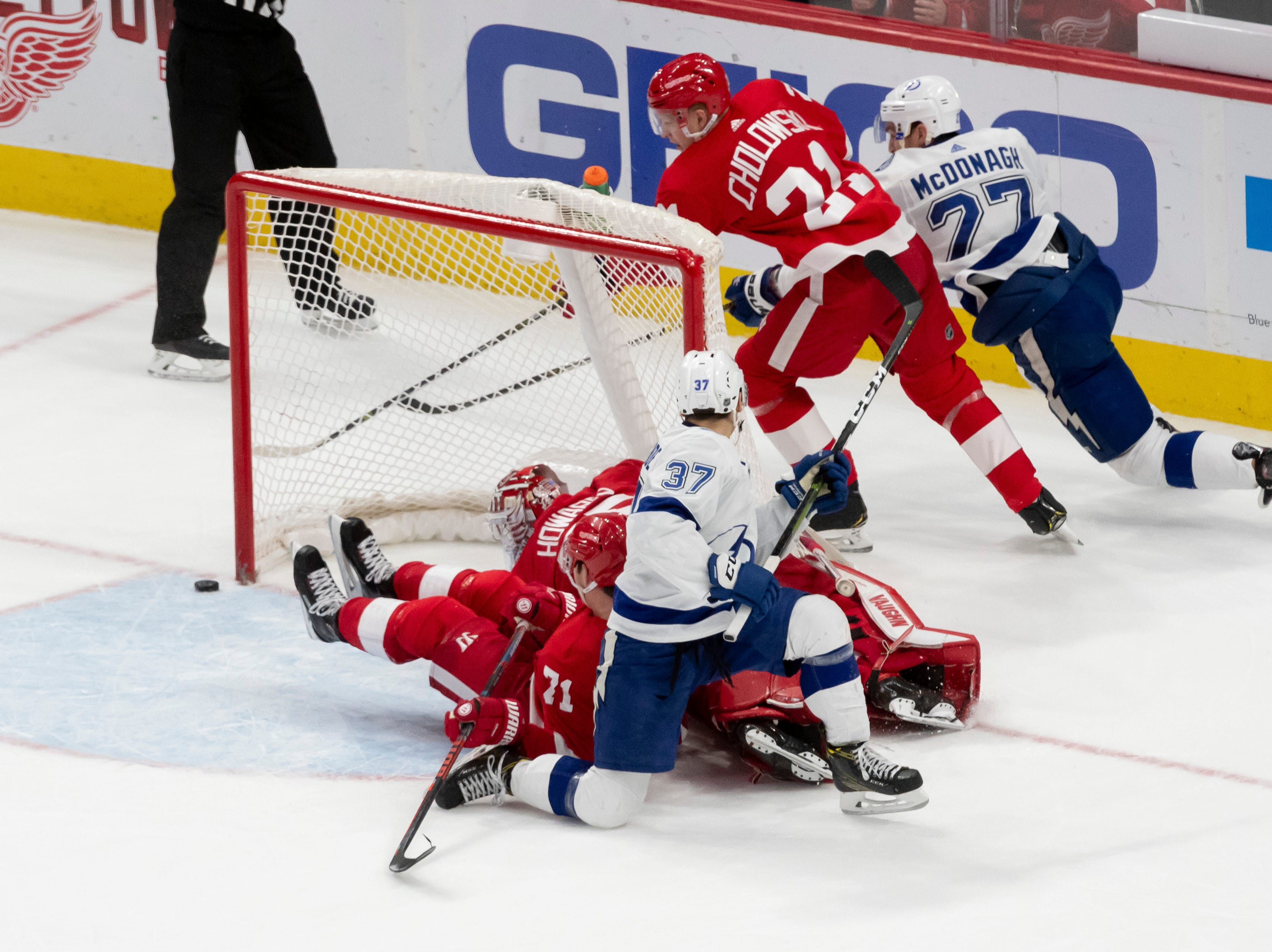 The puck comes perilously close to the net during a scrum in front of Detroit goaltender Jimmy Howard in the overtime period.