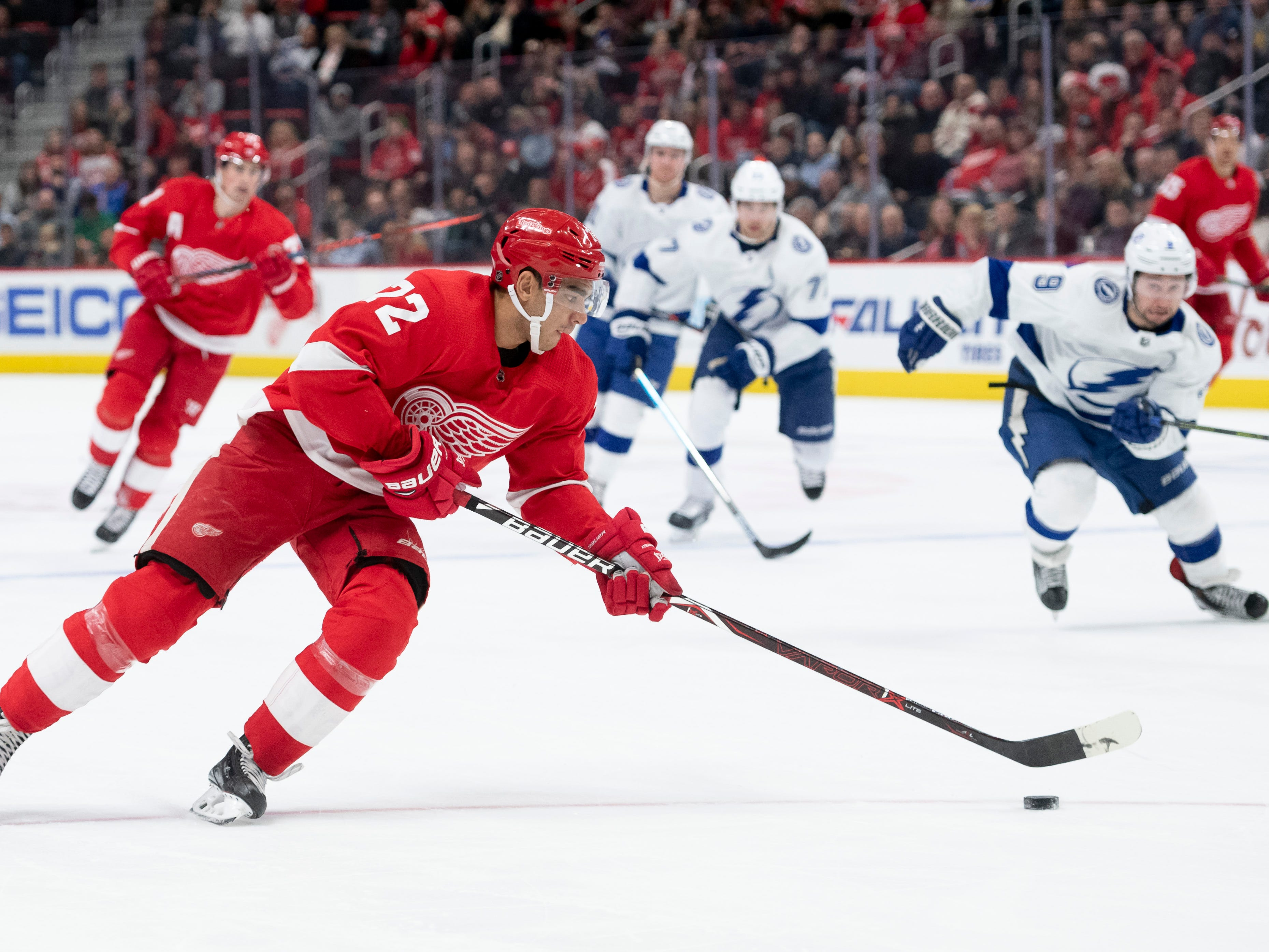Detroit center Andreas Athanasiou moves the puck into Tampa's zone in the first period.