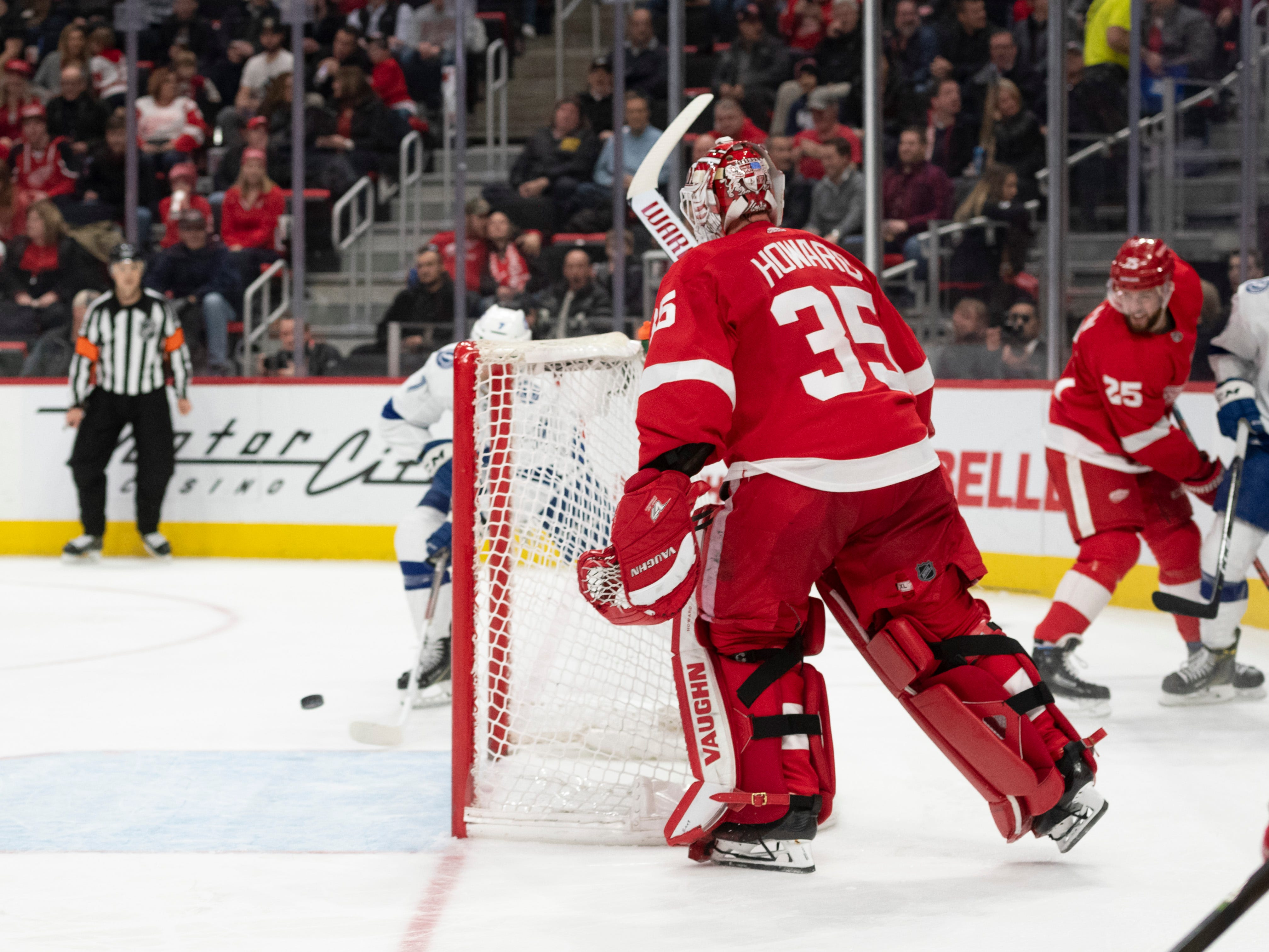 Detroit goaltender Jimmy Howard leaves the net wide open while trying to clear the puck which resulted in an easy goal by Tampa Bay right wing Mathieu Joseph in the second period.