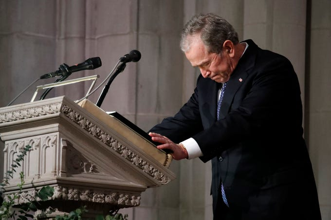Former President George W. Bush pauses to collect himself as he delivers the eulogy during the funeral for his father, former President George H.W. Bush, at the National Cathedral in Washington, D.C., on Wednesday, Dec. 5, 2018.