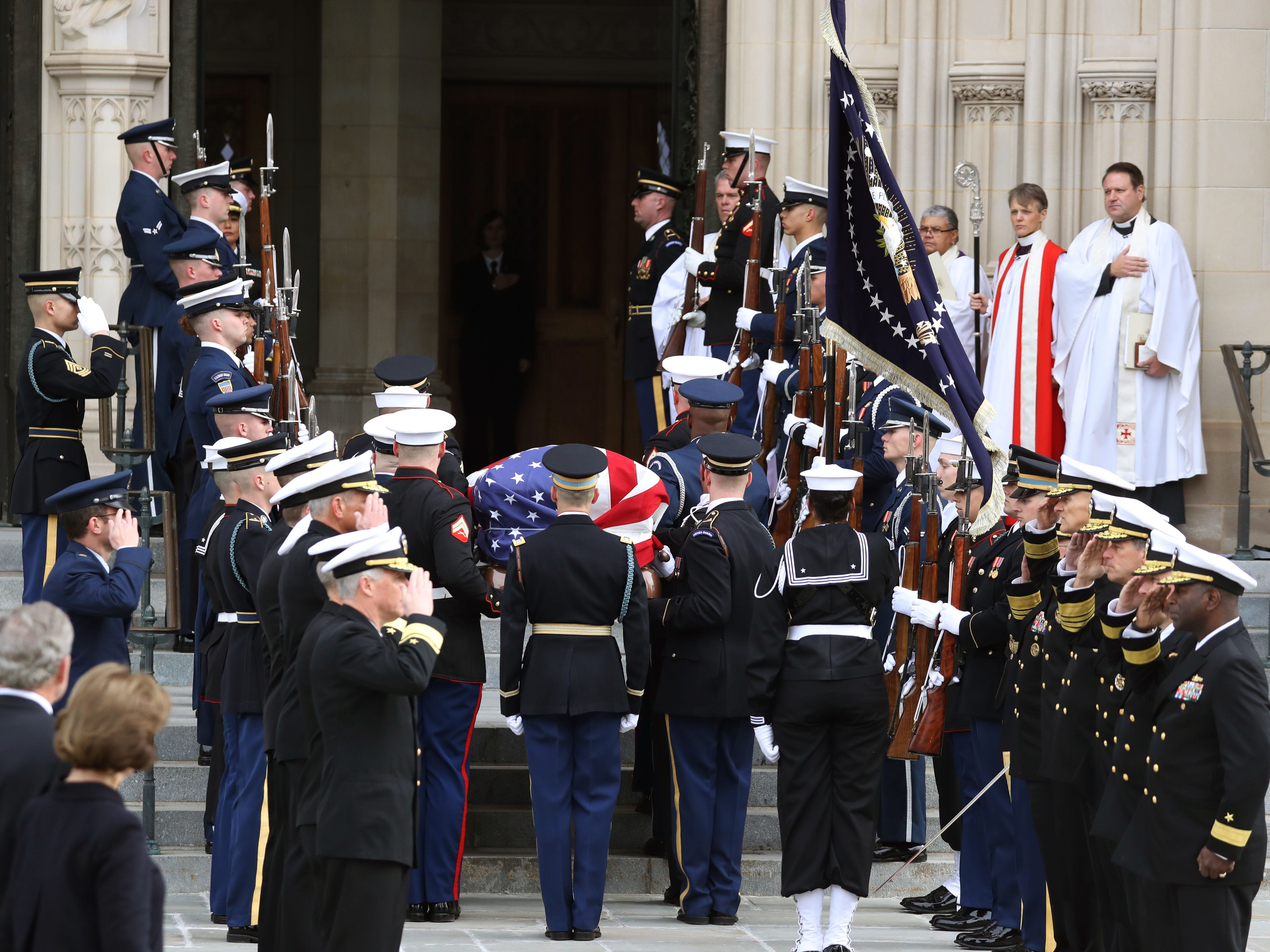 The remains of former President George H. W. Bush arrive at the National Cathedral in Washington, D.C., for his funeral.