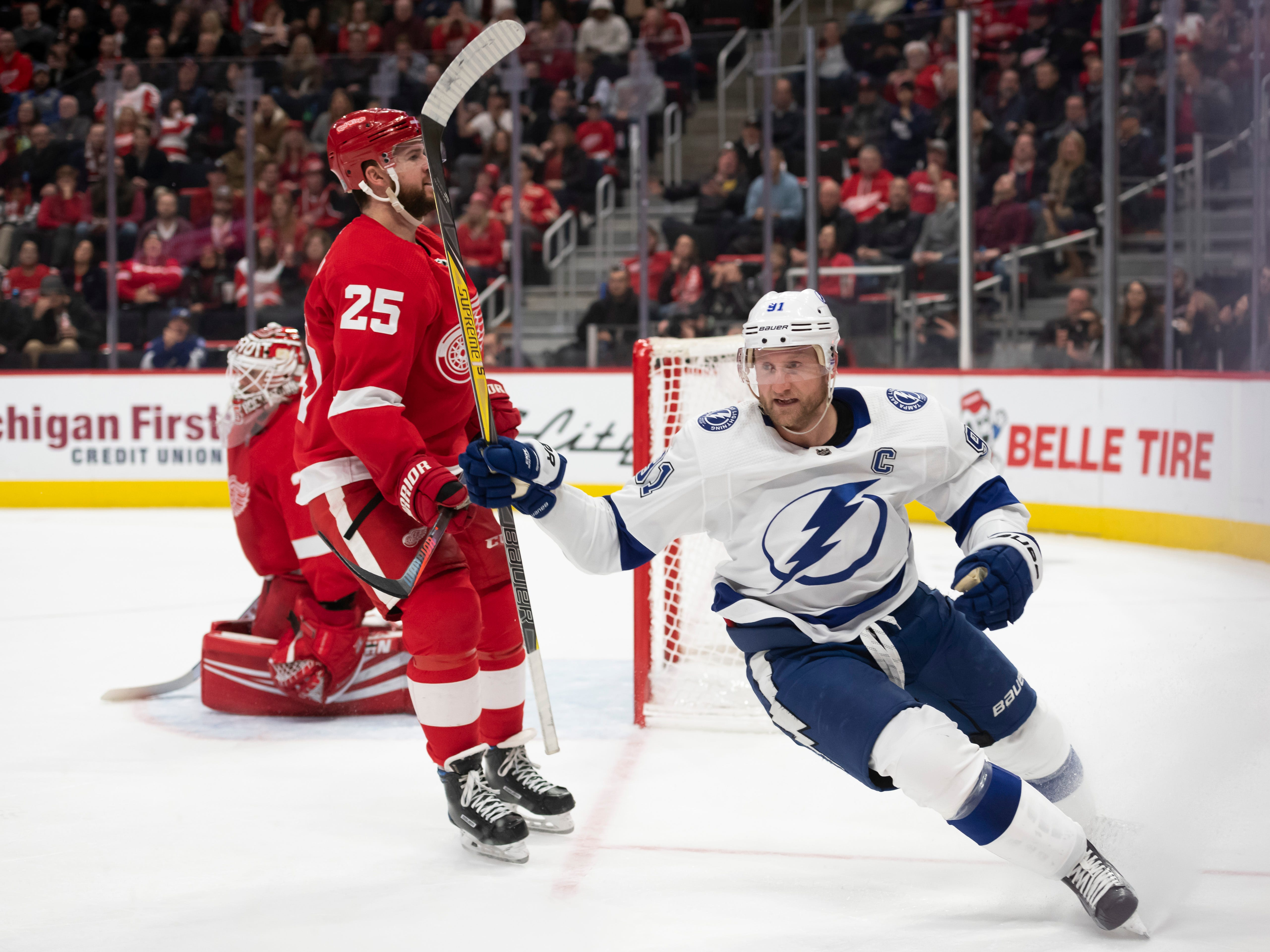 Tampa Bay center Steven Stamkos celebrates his second period goal in front of Detroit goaltender Jimmy Howard and defenseman Mike Green in the second period.