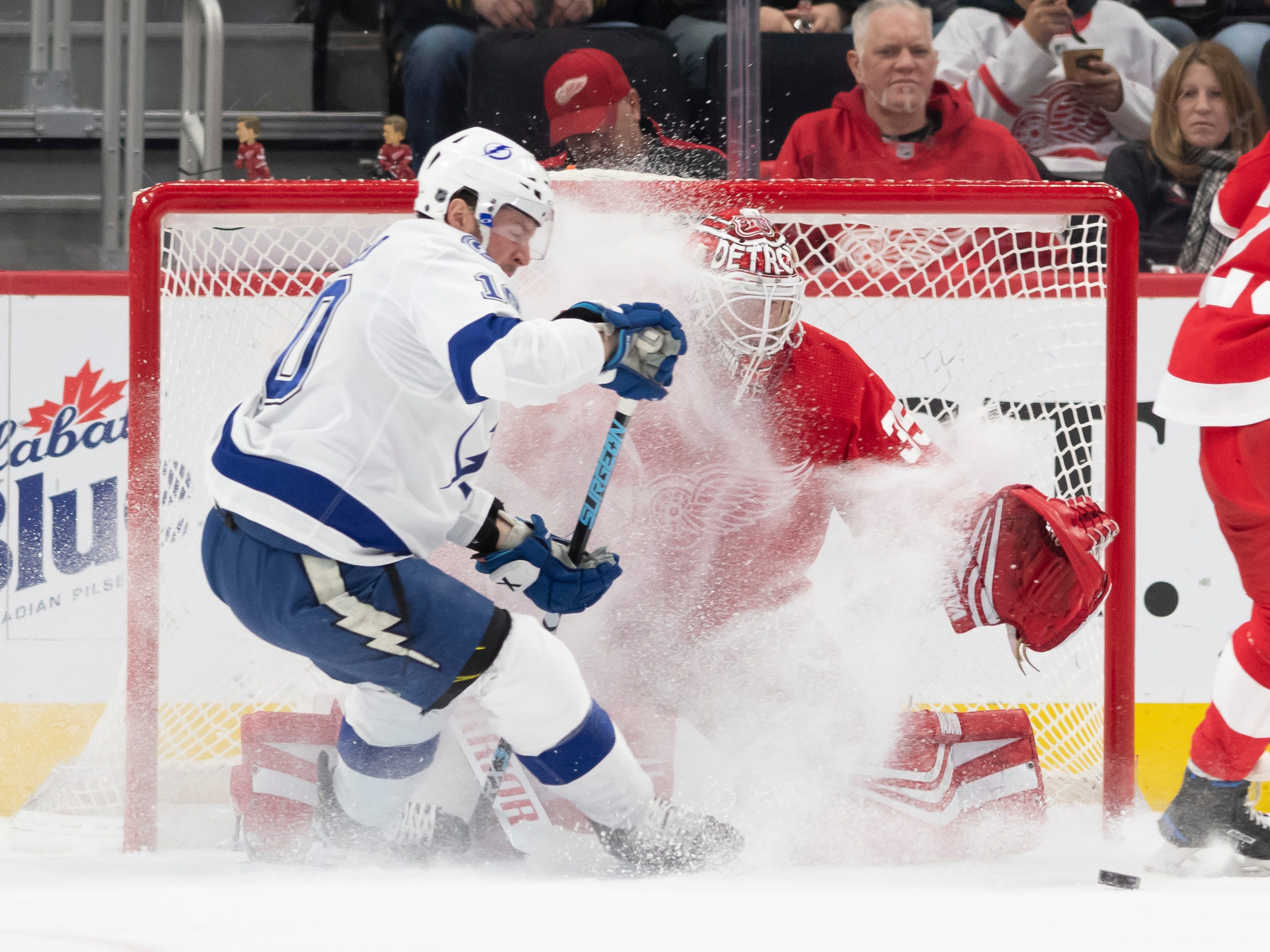 Tampa Bay center J.T. Miller tries to get the puck past Detroit goaltender Jimmy Howard in the first period.