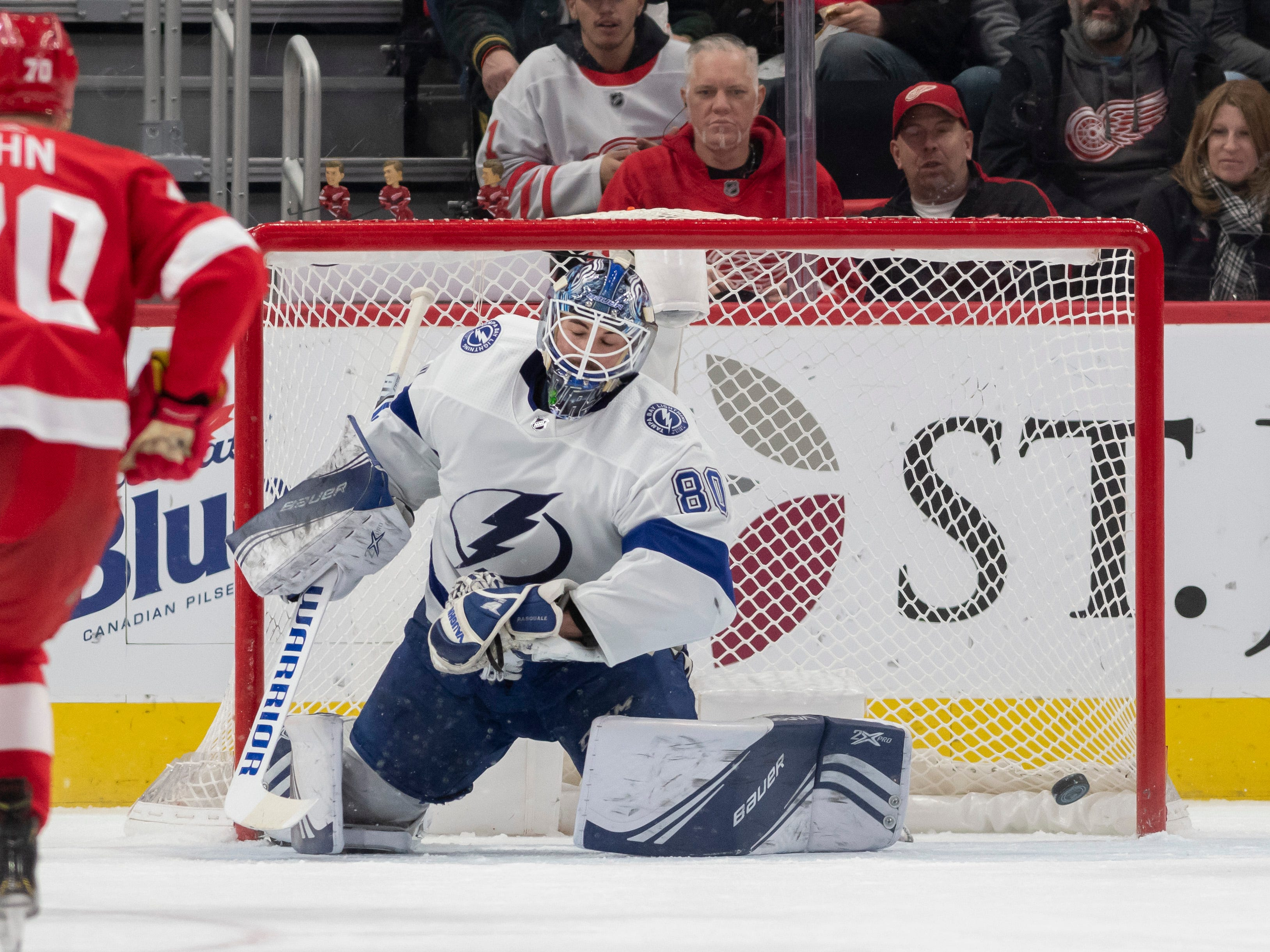 The puck slips past Tampa Bay goaltender Edward Pasquale for a goal by Detroit center Frans Nielsen in the second period.
