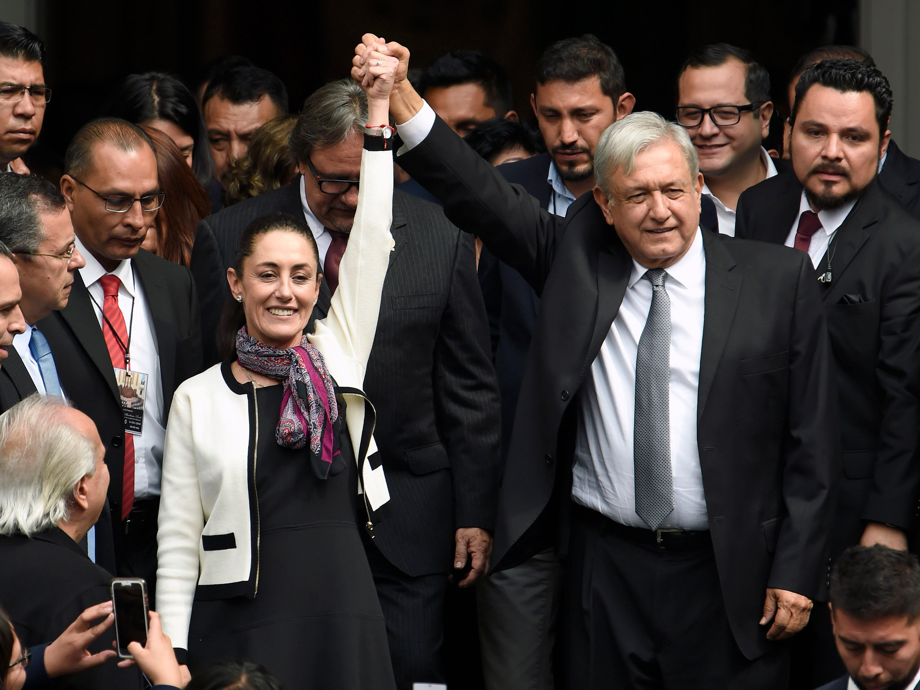 Mexican President Andres Manuel Lopez Obrador raises the hand of Mexico City's new governor, Claudia Sheinbaum, after her swearing-in ceremony at the local Congress in Mexico City on Dec. 5, 2018. Sheinbaum is the first woman to be elected governor of Mexico City.