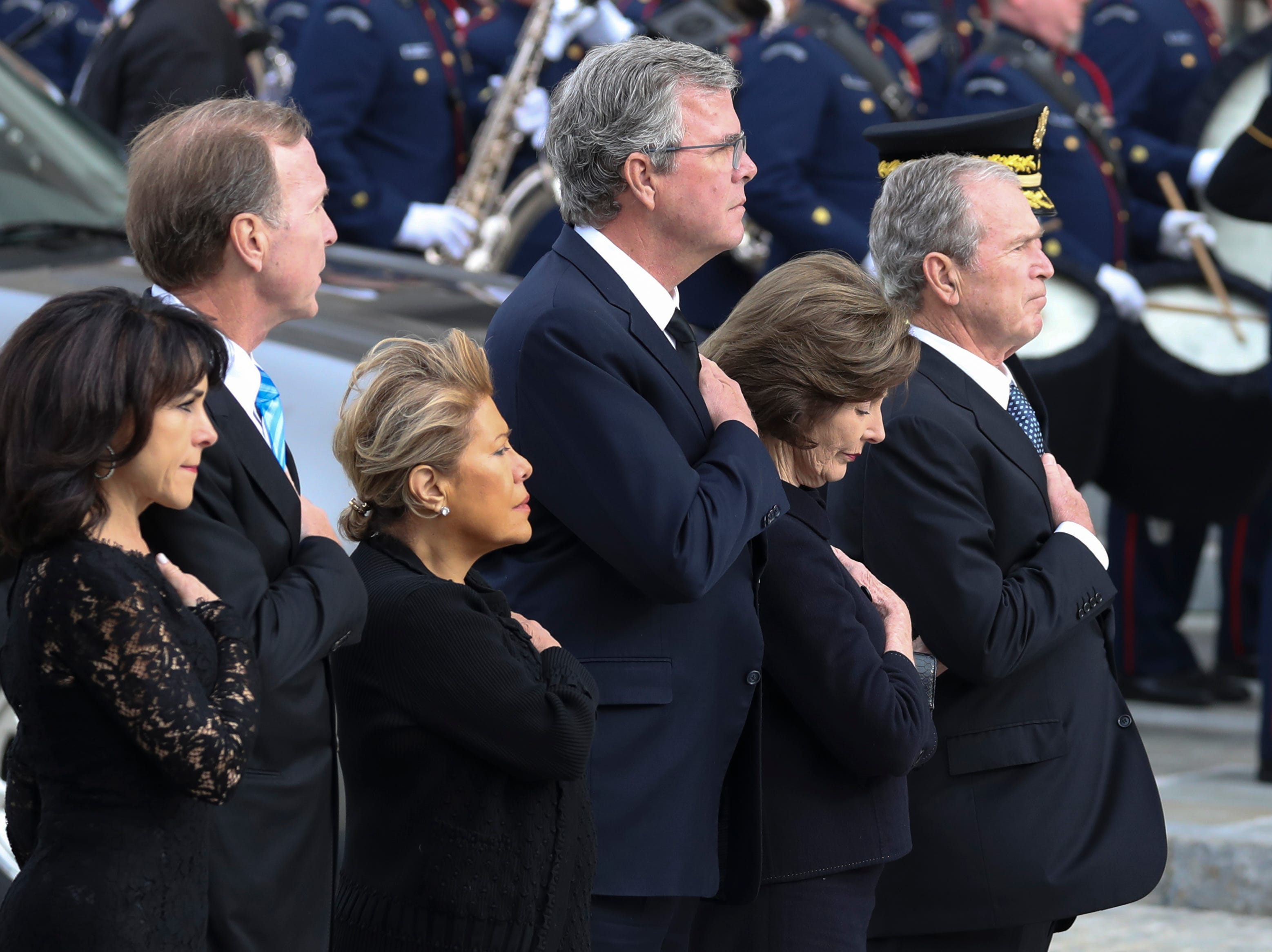 Maria Bush, left, Neil Bush, Columba Bush, former Florida Gov. Jeb Bush, former first lady Laura Bush and former President George W. Bush arrive for the funeral.
