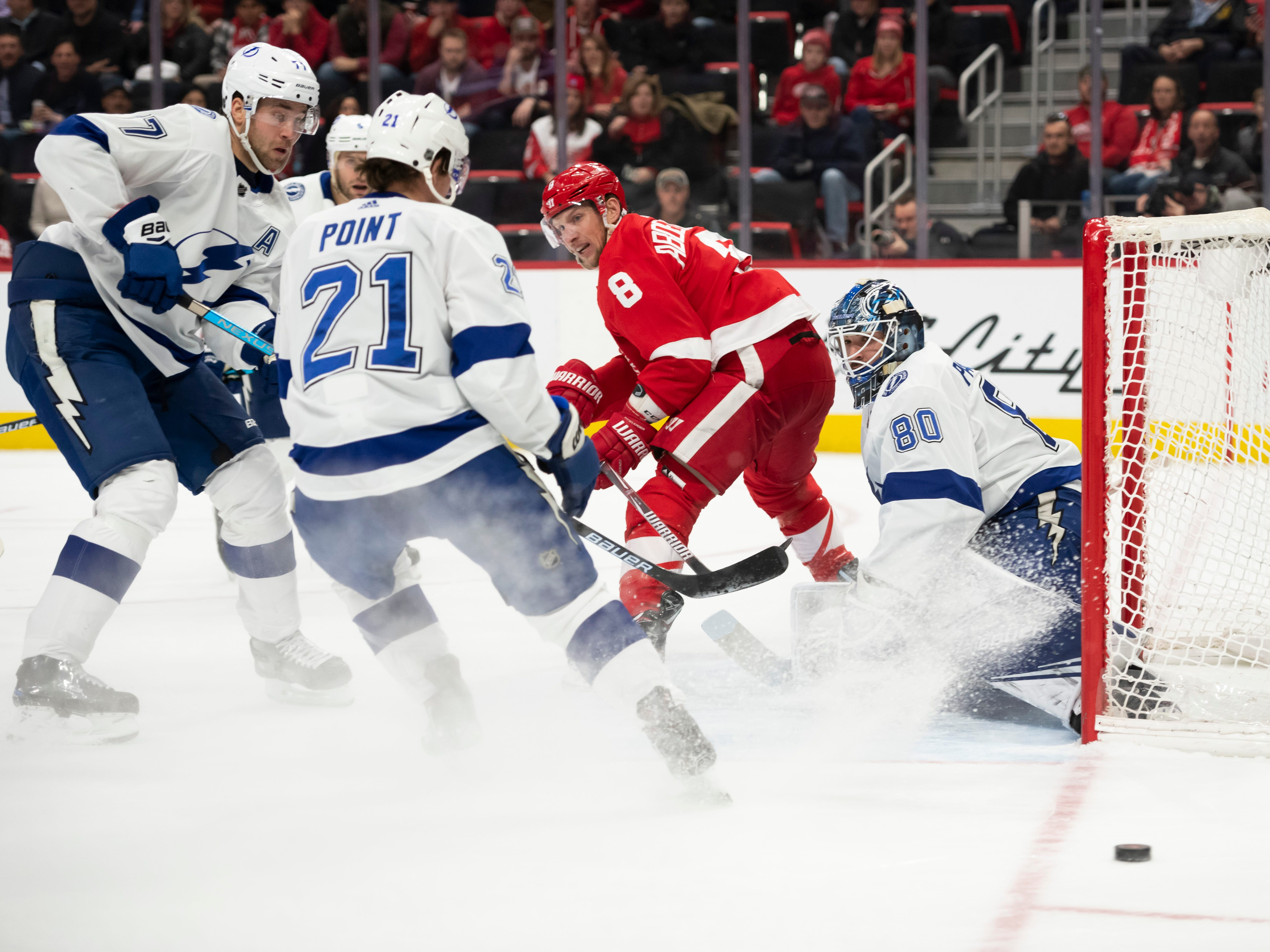 Detroit left wing Justin Abdelkader fights for position in front of Tampa's net in the first period.