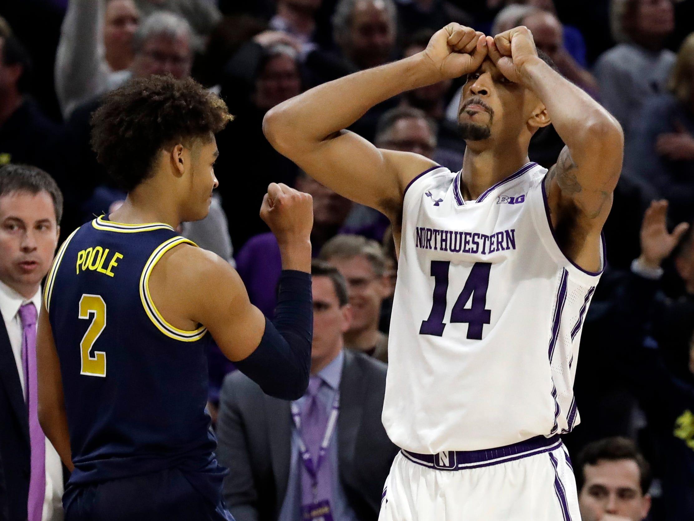 Northwestern guard Ryan Taylor, right, reacts after missing a basket as Michigan guard Jordan Poole celebrates after Michigan defeated Northwestern 62-60.