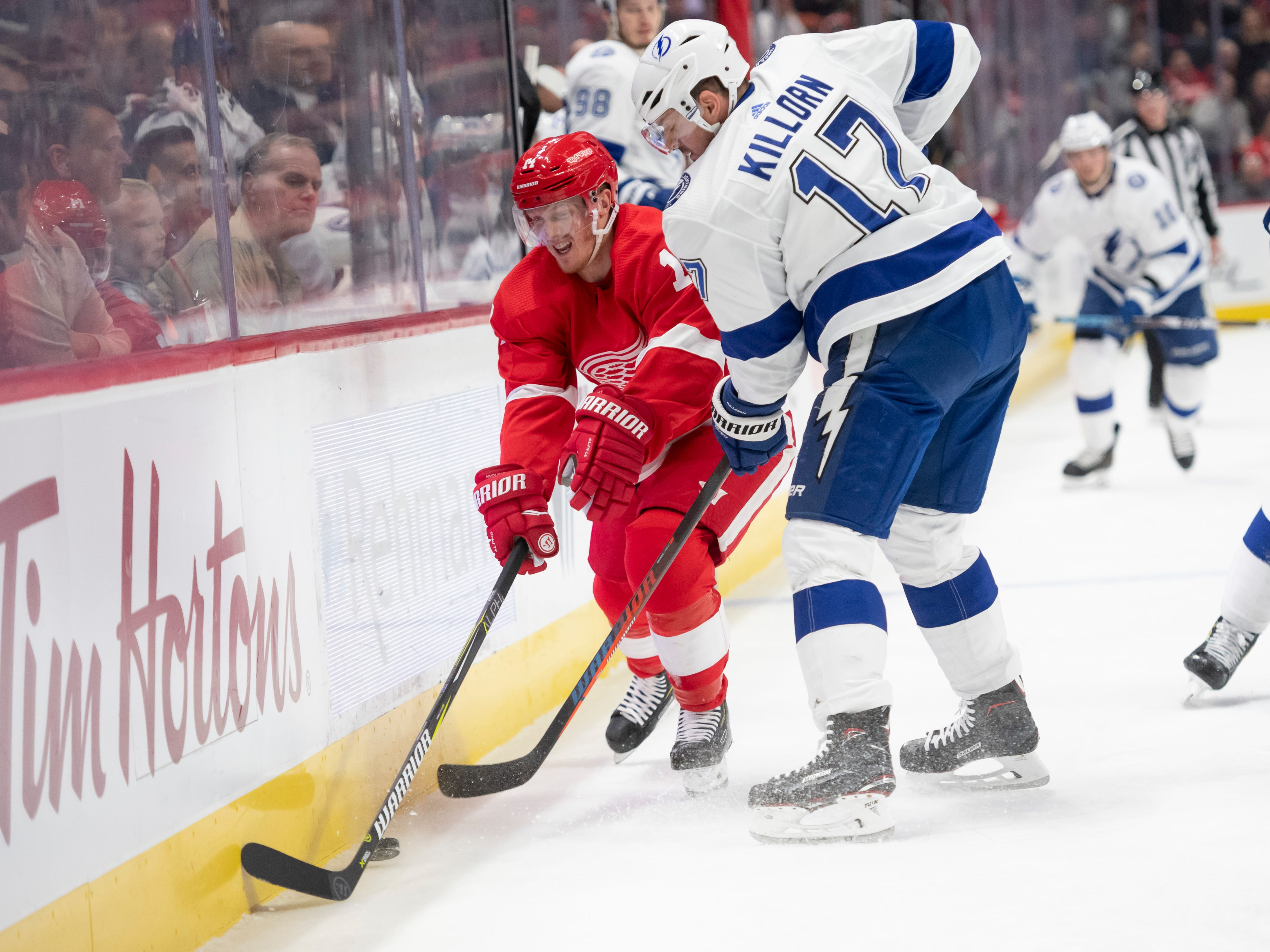 Detroit center Gustav Nyquist battles for the puck with Tampa Bay center Alex Killorn in the first period.