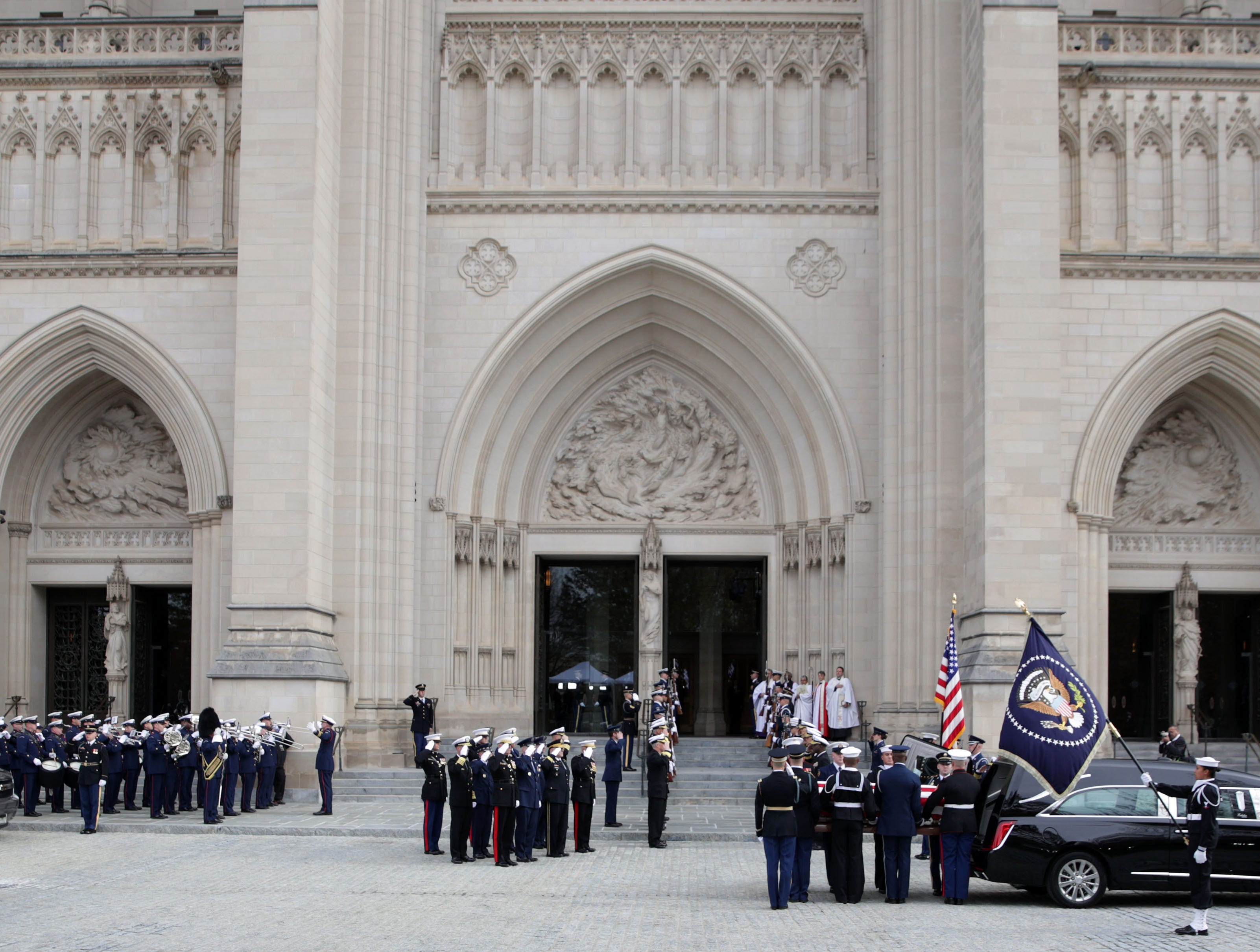 A joint service honor guard carries the casket of former President George H.W. Bush to an awaiting hearse after the service.