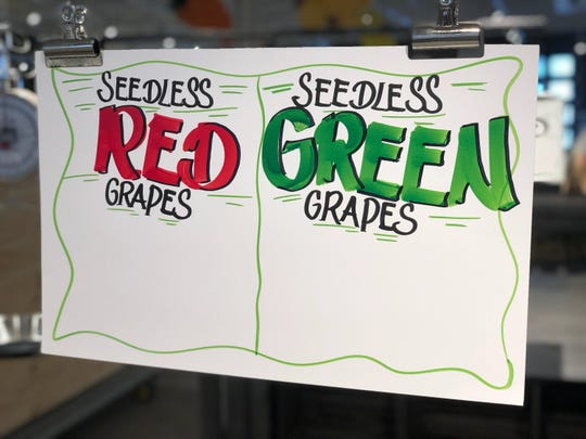 Produce signs get ready for prices at the new Nino's in Bloomfield Township.