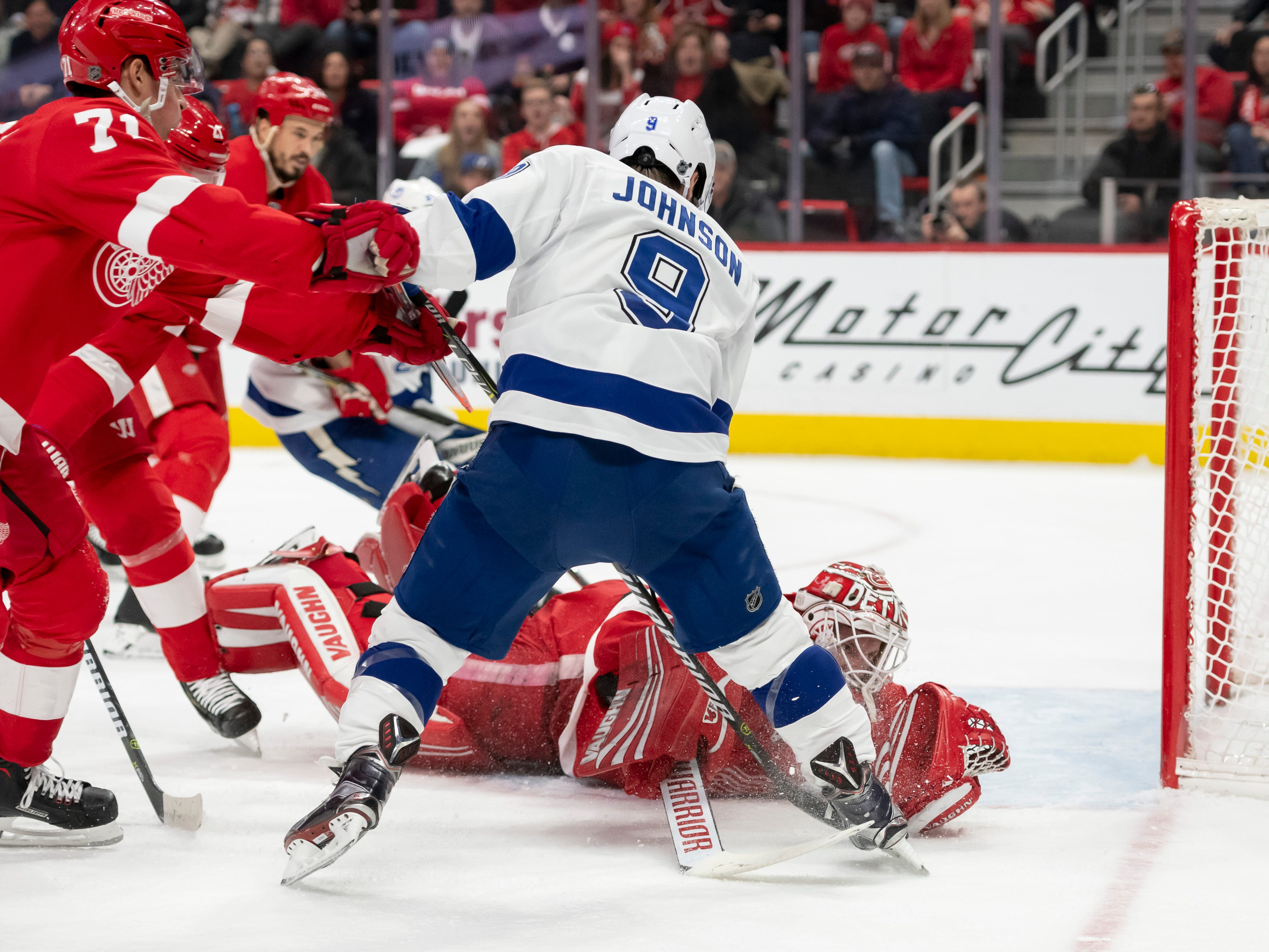 Tampa Bay center Tyler Johnson can't get the puck past Detroit goaltender Jimmy Howard in the second period.