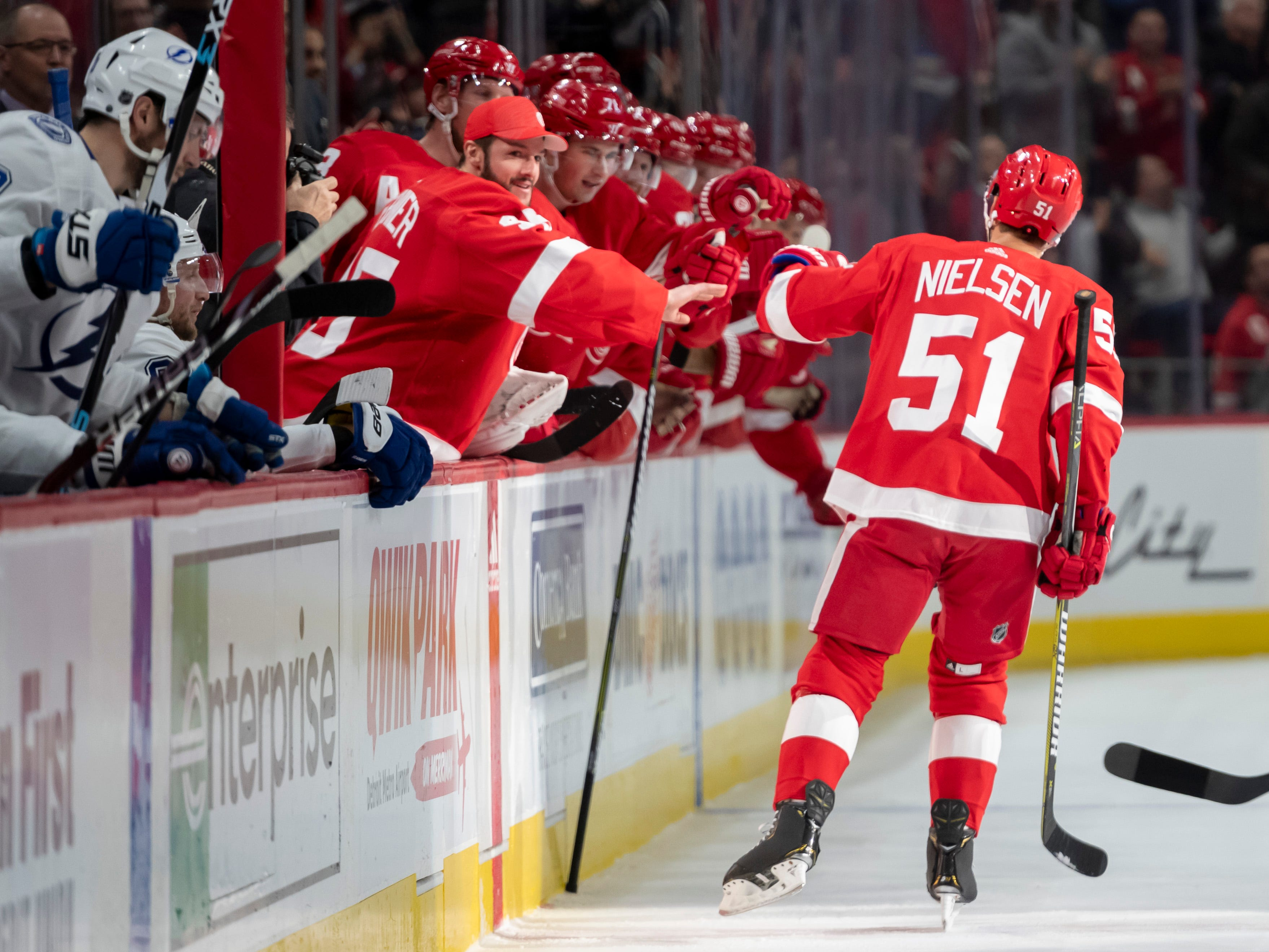 Detroit center Frans Nielsen gets high fives from his teammates after scoring in the first period.