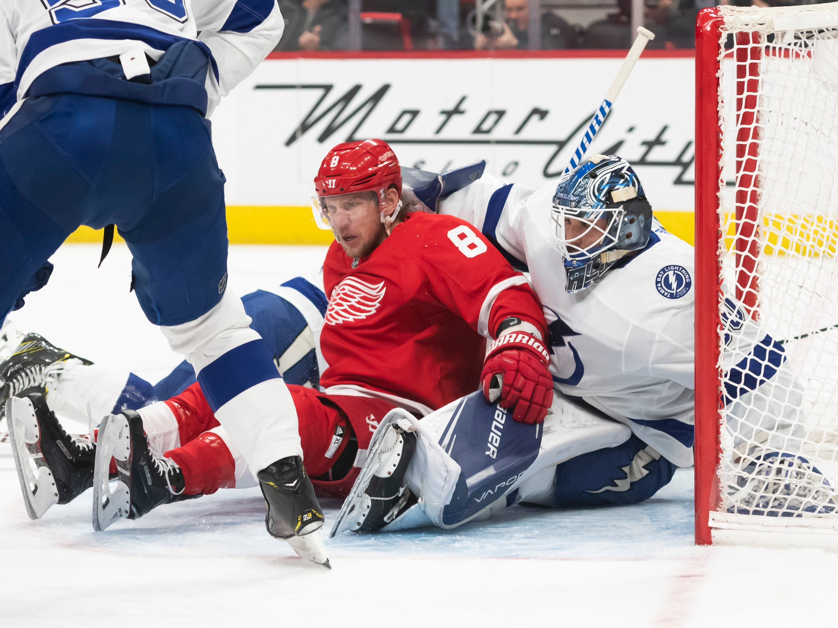 Detroit left wing Justin Abdelkader ends up in the lap of Tampa Bay goaltender Edward Pasquale in the first period.