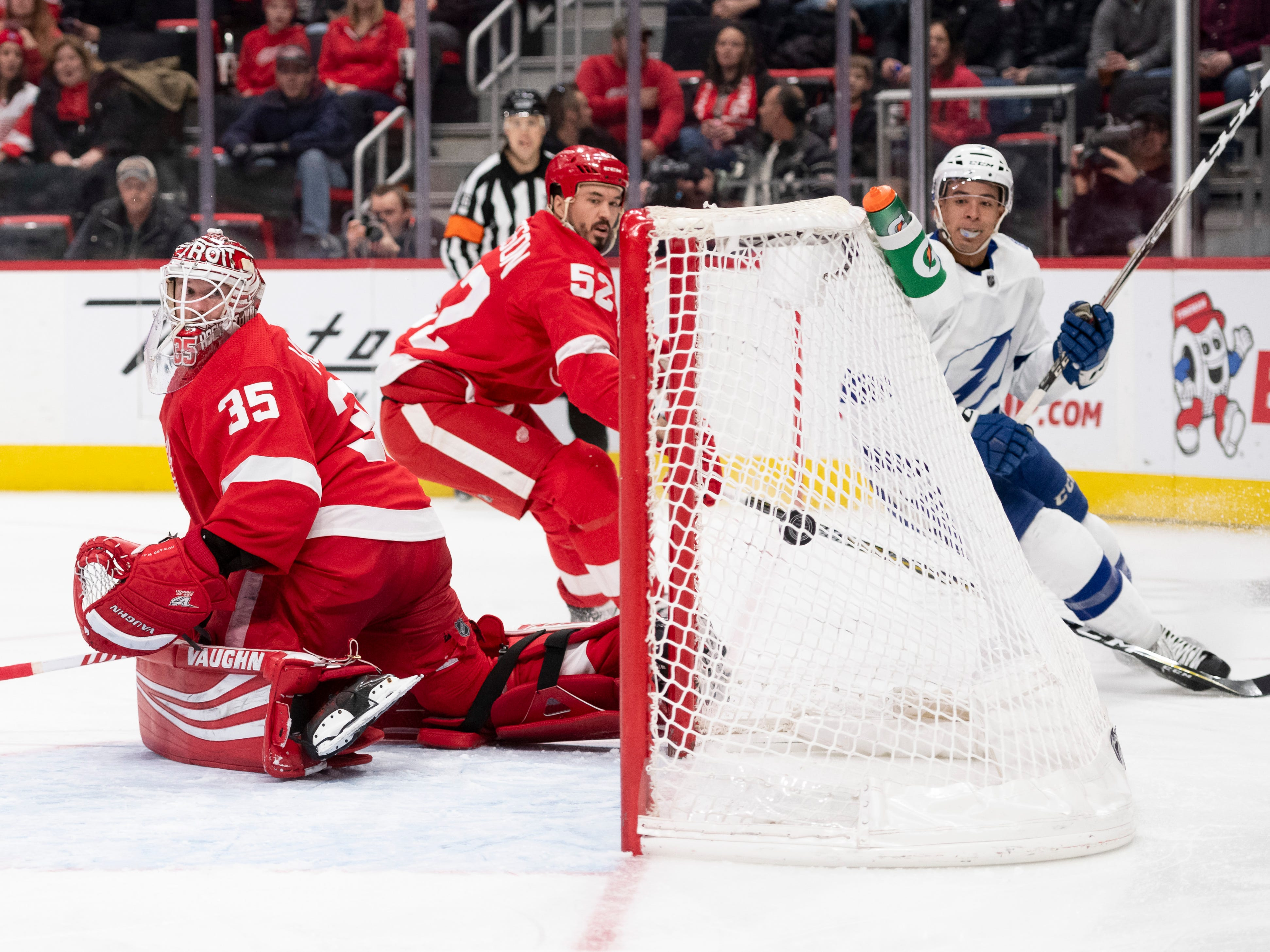 Tampa Bay right wing Mathieu Joseph, right, watches his goal fly past Detroit goaltender Jimmy Howard and defenseman Jonathan Ericsson in the second period.