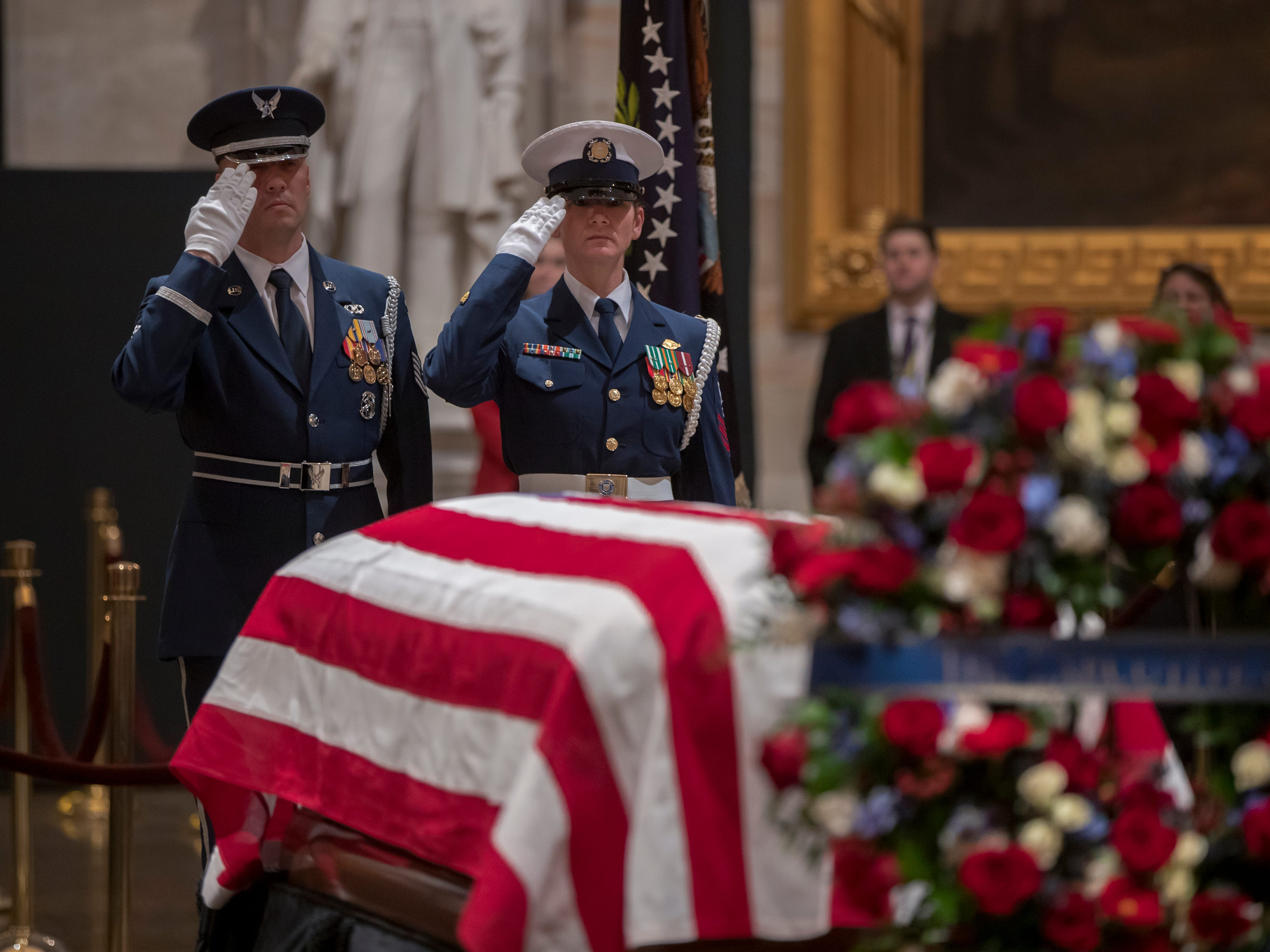Wednesday morning, a final salute is rendered by the honor guard standing watch over the flag-draped casket of the late president as the public viewing comes to an end at the U.S. Capitol Rotunda.