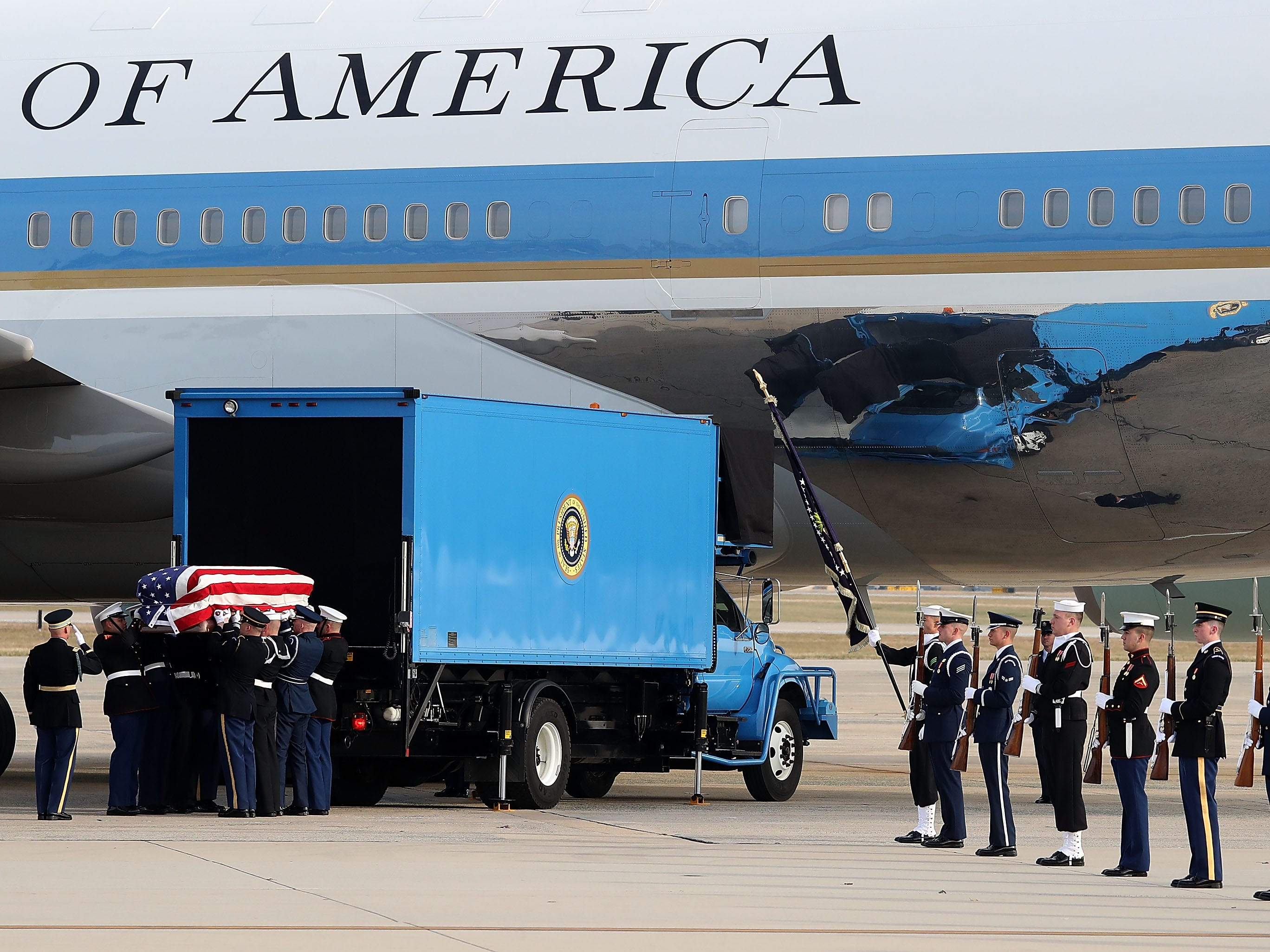 "A  joint military honor guard carries the casket of former President George H.W. Bush before it is loaded onto a U.S. Air Force 747, that is being called ""Special Mission 41,"" at  Andrews Air Force Base, Maryland. His remains will be buried on Dec. 6 at Texas A&M University on the grounds of the George H.W. Bush Presidential Library Center."
