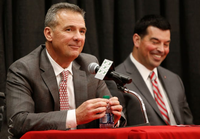 Urban Meyer answers questions during a news conference announcing his retirement Tuesday.