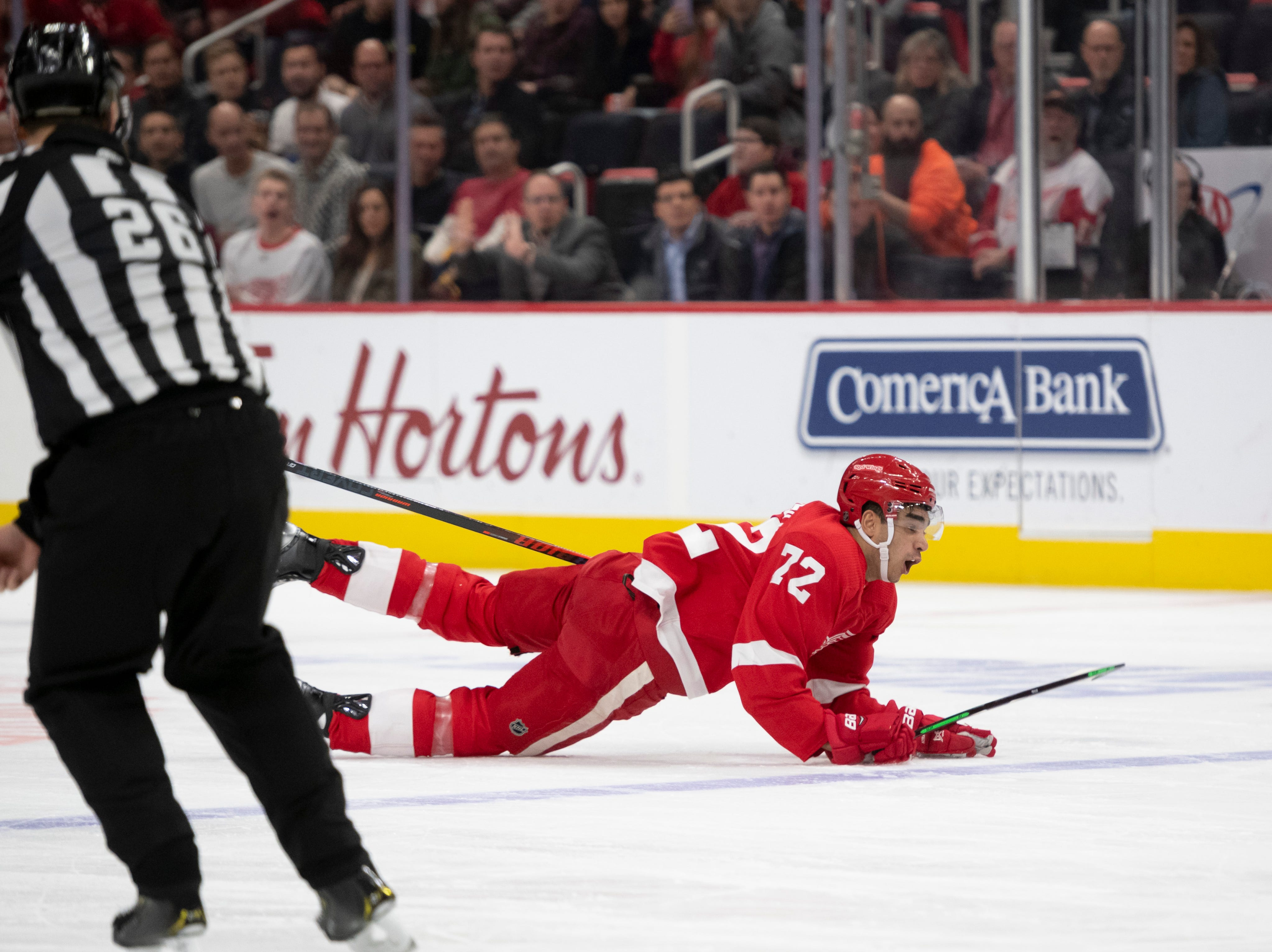Detroit center Andreas Athanasiou hits the ice after being hooked by Tampa Bay center Alex Killorn in the third period.