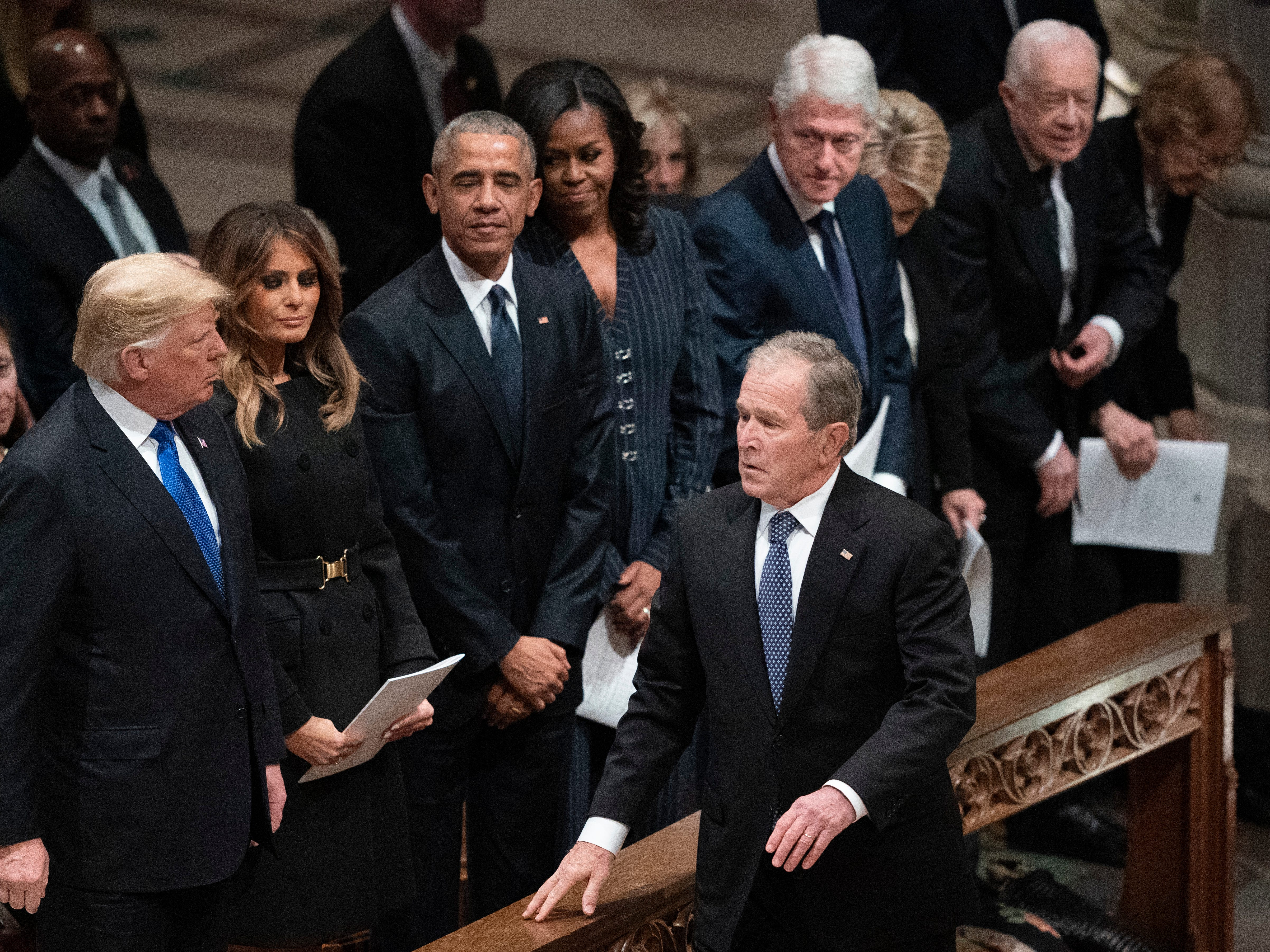 President George W. Bush walks to his seat after greeting President Donald Trump, first lady Melania Trump, former President Barack Obama, Michelle Obama, former President Bill Clinton, former Secretary of State Hillary Clinton, former President Jimmy Carter and Rosalynn Carter.