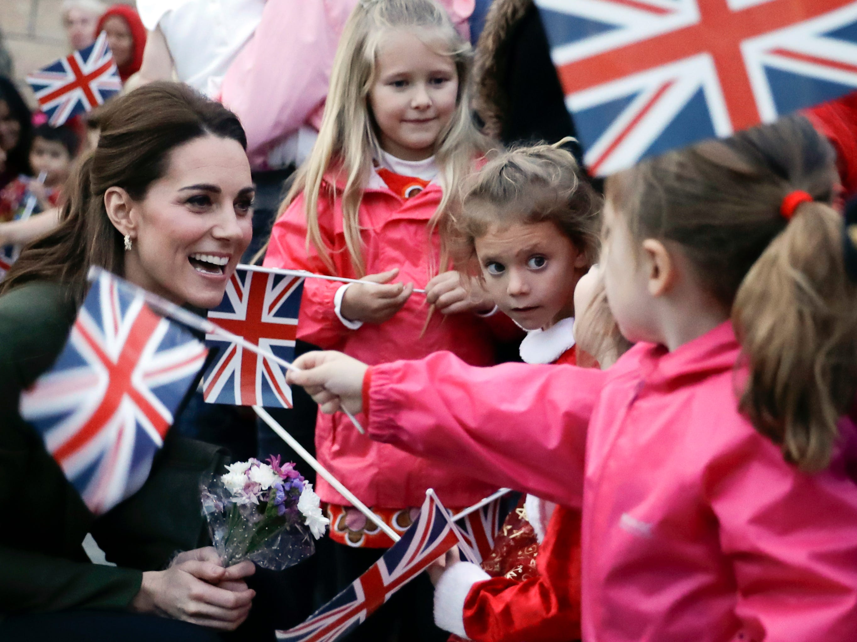 Kate, the Duchess of Cambridge, greets family members of personnel at the Akrotiri Royal Air Force base, near the south coastal city of Limassol, Cyprus, Wednesday, Dec. 5, 2018. The RAF Akrotiri is the home of the Cyprus Operations Support Unit, which supplies  operations in the region to protect the UK's strategic interests.
