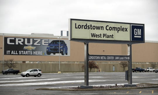 In this Nov. 27, 2018 photo, a sign is displayed at General Motors Lordstown West plant in Lordstown, Ohio. It was working-class voters who bucked the area's history as a Democratic stronghold and backed Donald Trump in 2016, helping him win the White House with promises to put American workers first and bring back disappearing manufacturing and steel jobs. Whether they stick with him after this week's GM news and other signs that the economy could be cooling will determine Trump's political future. (AP Photo/Tony Dejak)