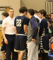 Elmira Notre Dame boys basketball coach Nick Weiermiller talks to his team during a timeout against Thomas A. Edison on Dec. 4, 2018 at Edison High School.