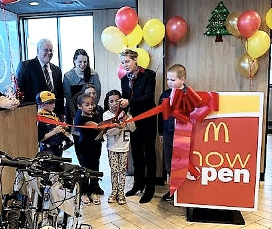 Owner Courtney Feehan cuts the ribbon on the renovated McDonald's restaurant in Southtown Plaza in the Town of Southport.