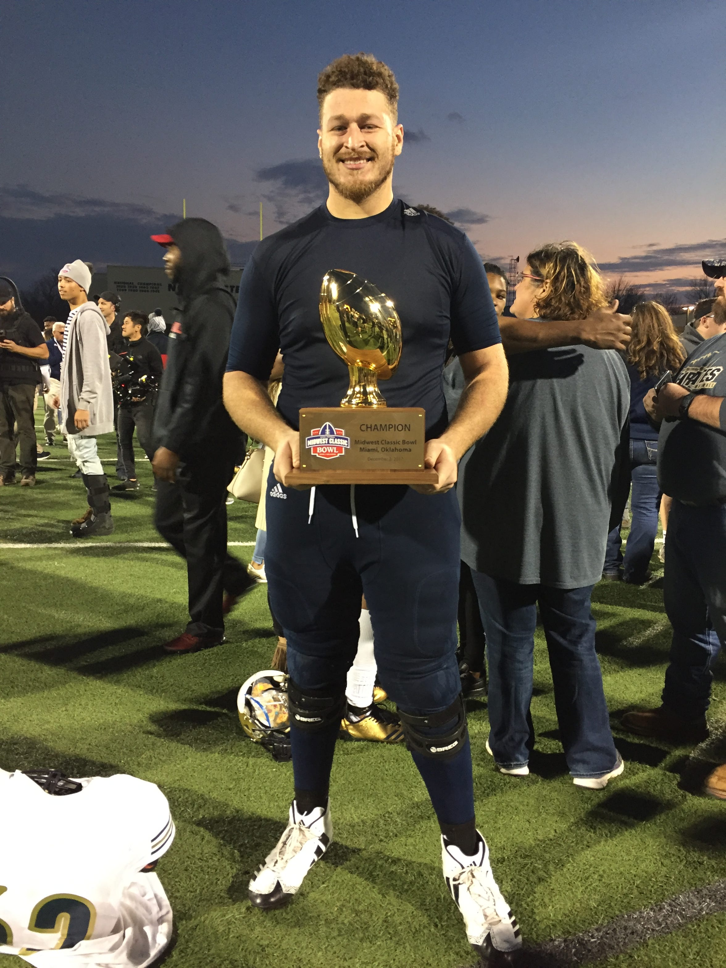 Brishaun Horne poses with a trophy after winning a bowl game with Independence Community College in 2017.
