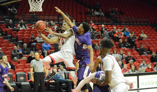 Arkansas State guard Ty Cockfield looks to finish near the rim over Evansville's Marty Hill on Tuesday night.