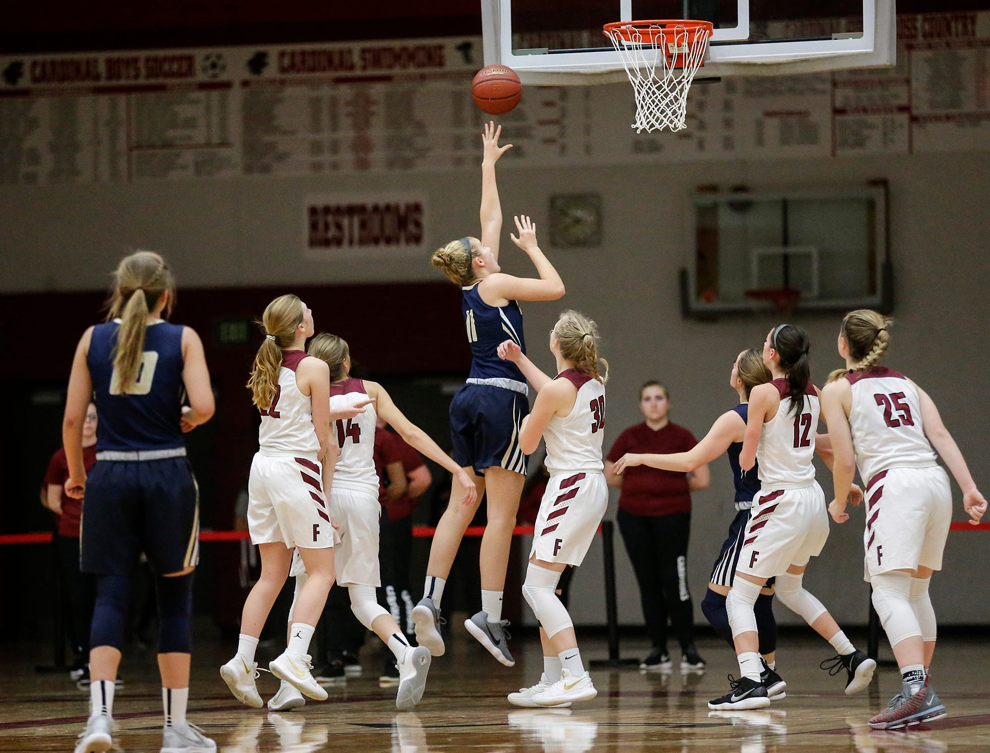 Appleton North High School girls basketball's Emma Erickson goes up for a basket against Fond du Lac High School during their game Tuesday, December 4, 2018 in Fond du Lac, Wisconsin. Doug Raflik/USA TODAY NETWORK-Wisconsin
