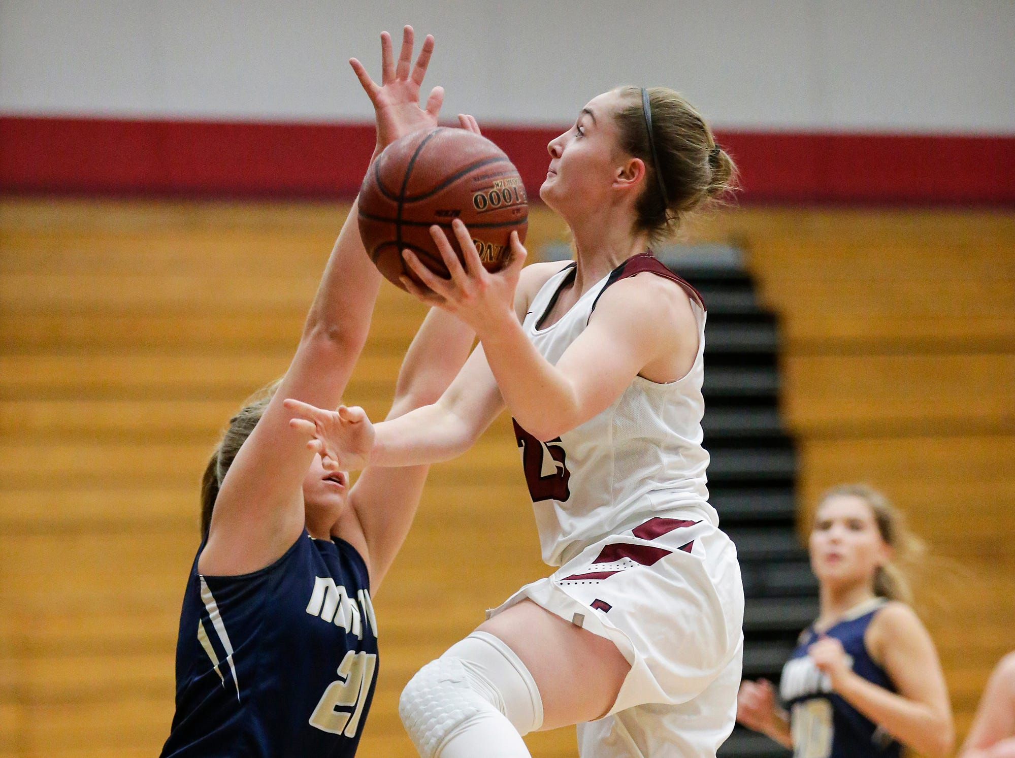 Fond du Lac High School girls basketball's Joslyn Herbeck goes up for a basket against Appleton North High School's Lilli Van Handel during their game Tuesday, December 4, 2018 in Fond du Lac, Wisconsin. Doug Raflik/USA TODAY NETWORK-Wisconsin